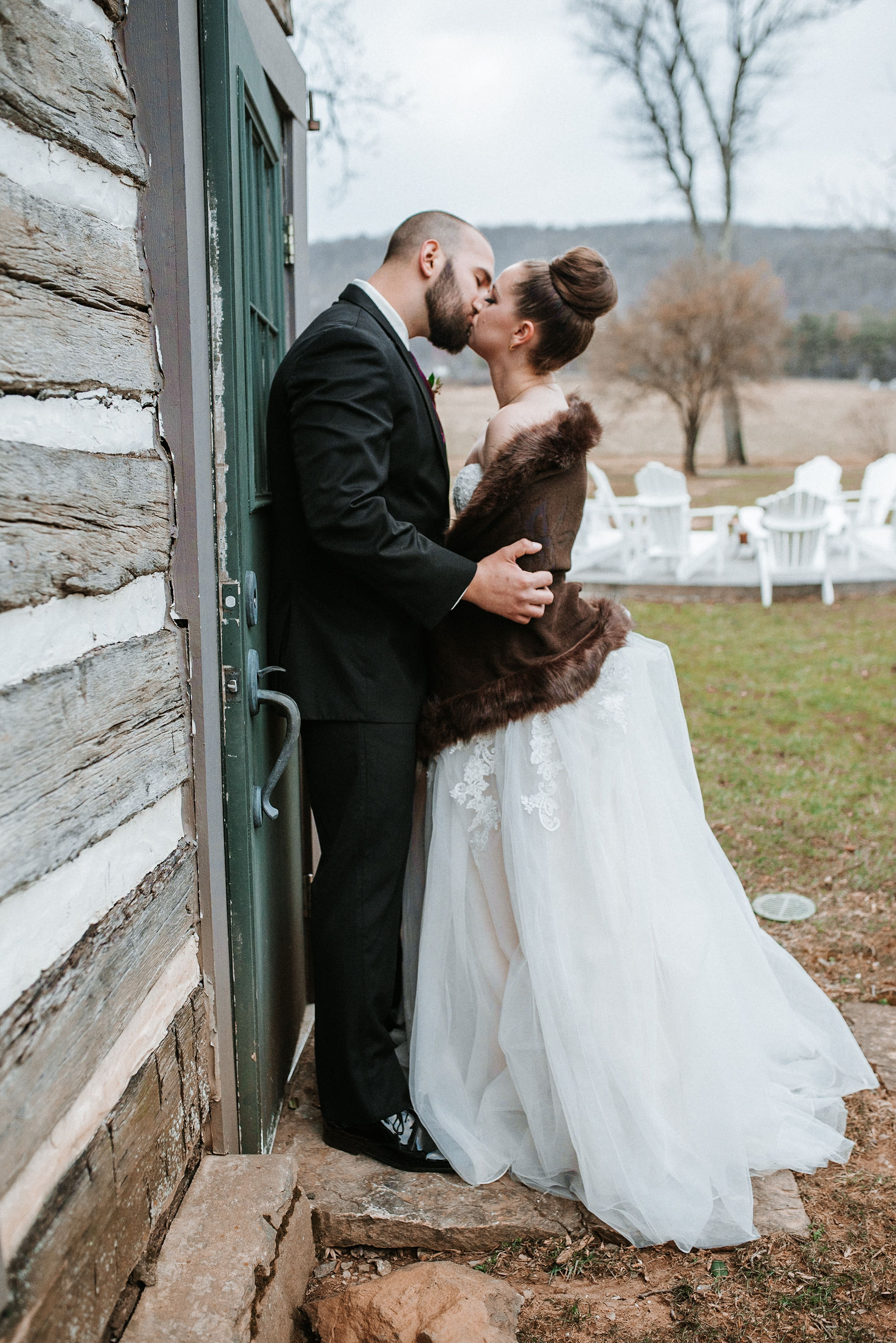 bride and groom kissing at Whitehall Estate