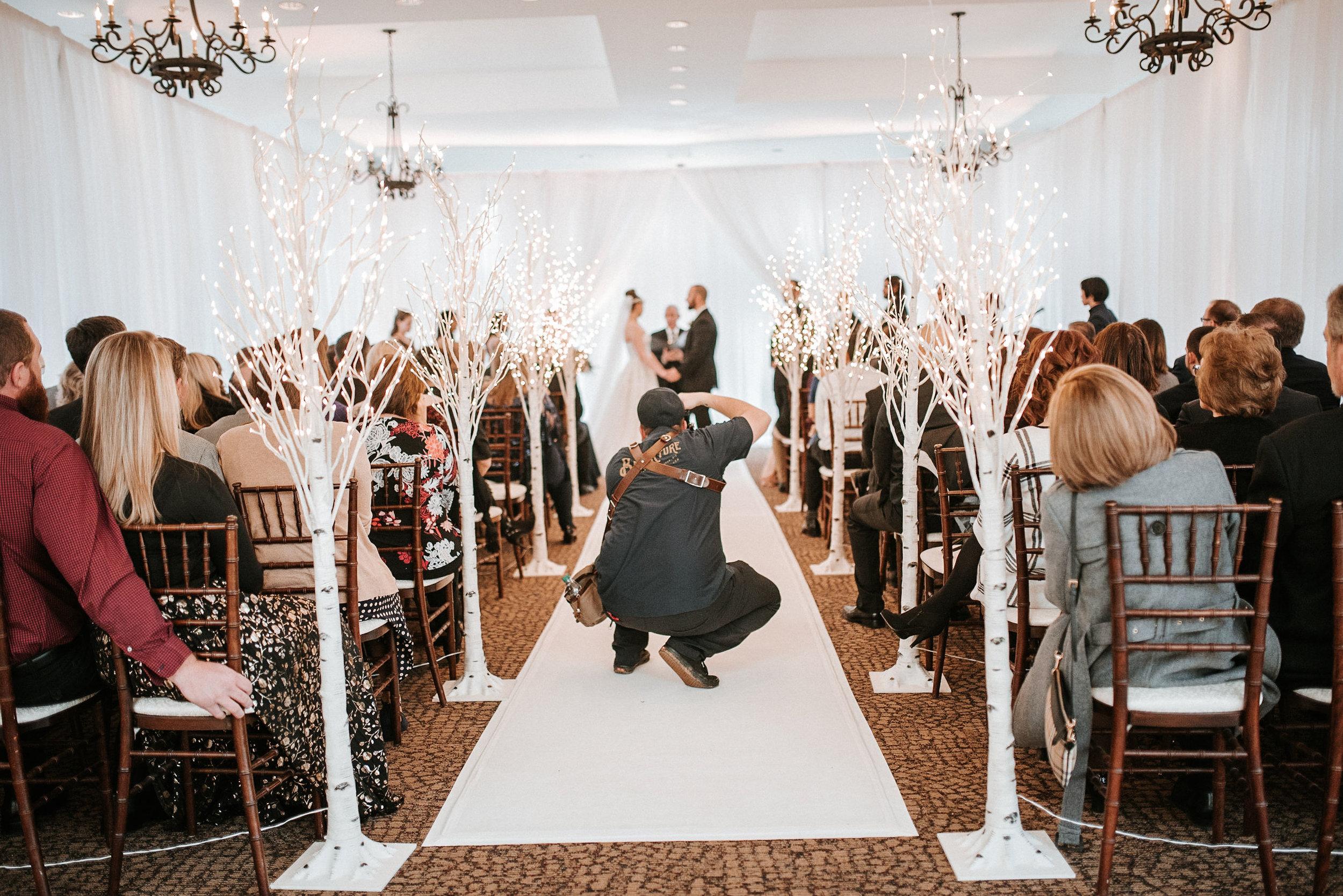 Wedding Photographer taking photos during a wedding