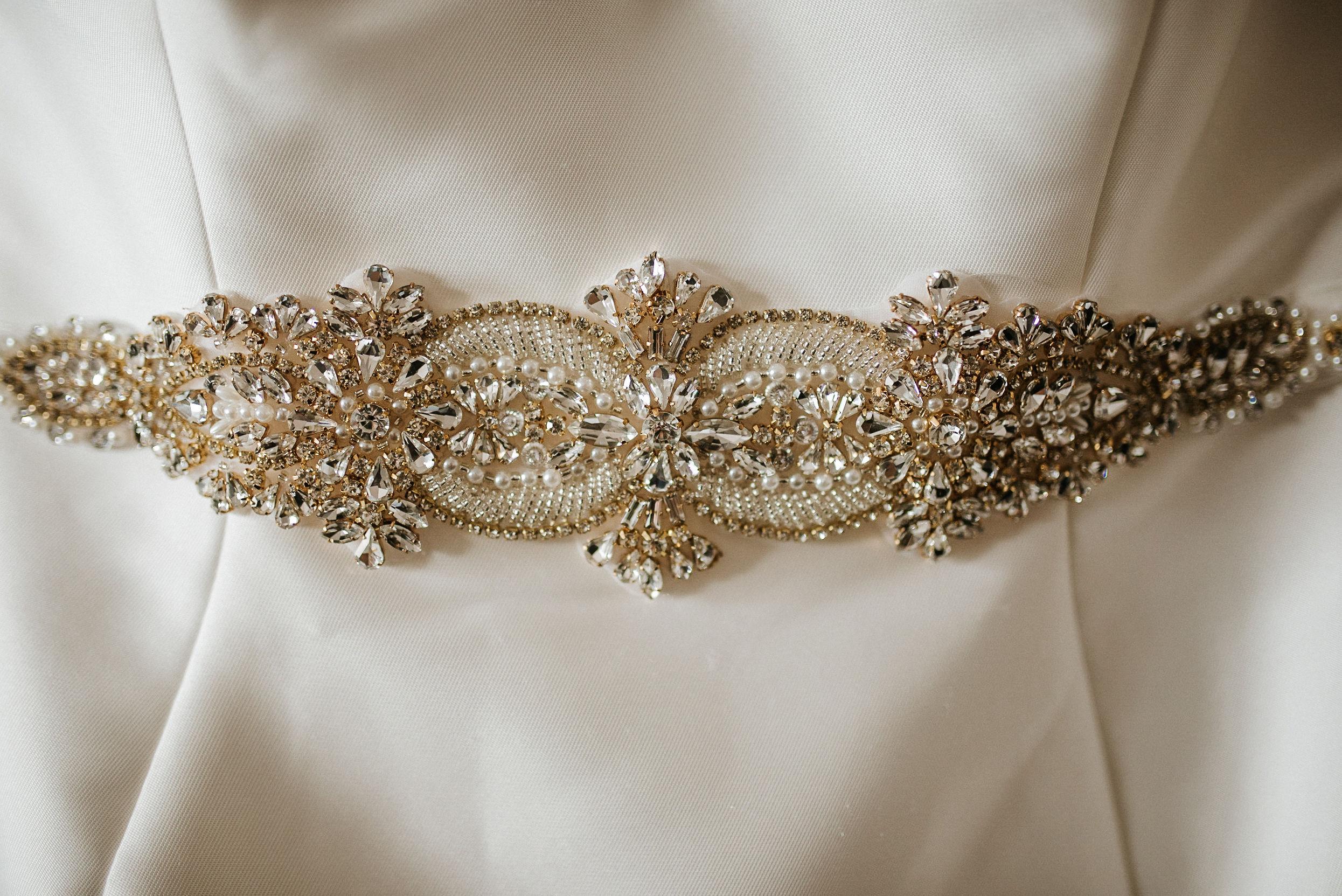 detail shot of wedding dress at the kimpton carlyle hotel