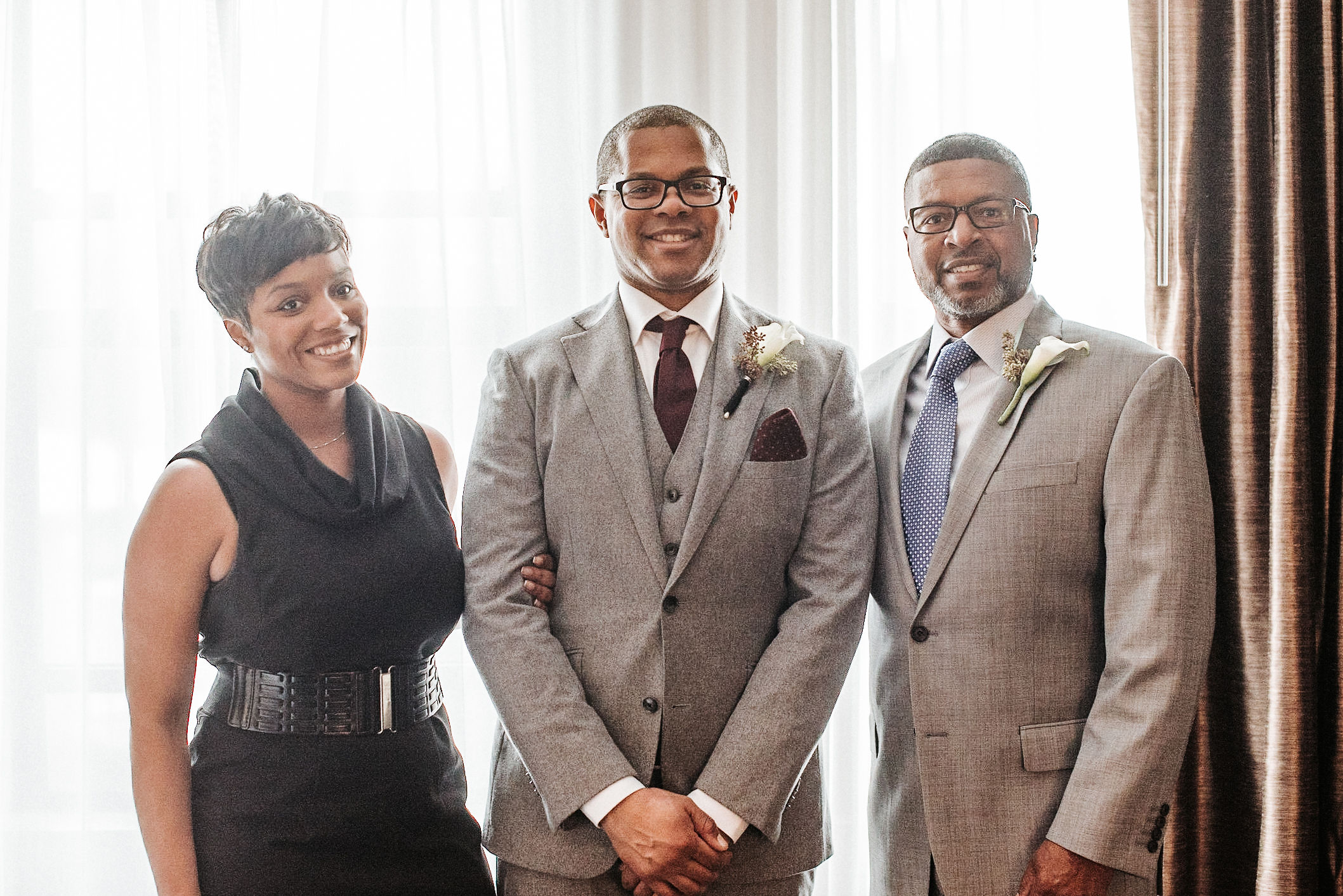 the groom with smiling with his family at the kimpton carlyle hotel