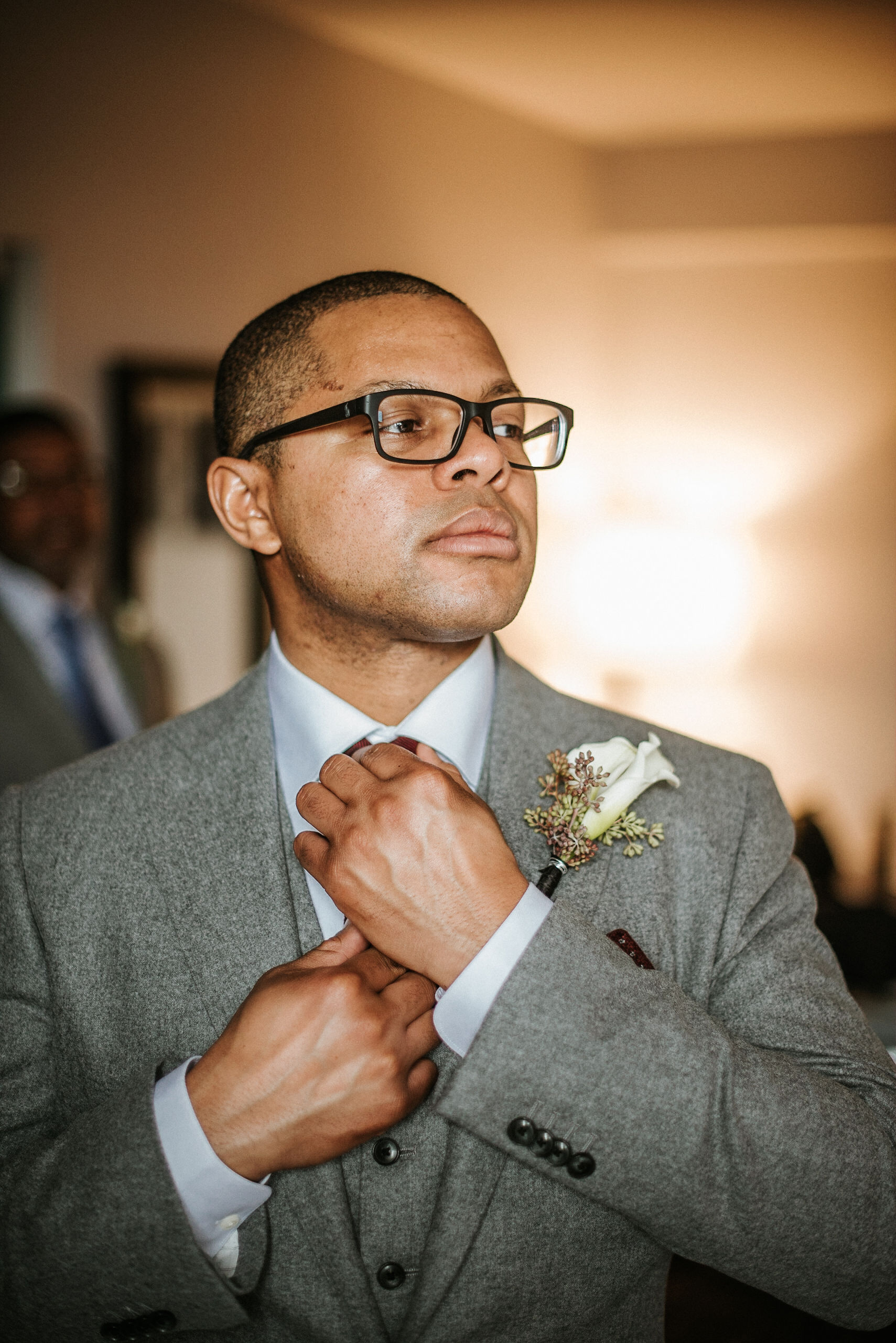 groom getting ready at the kimpton carlyle hotel