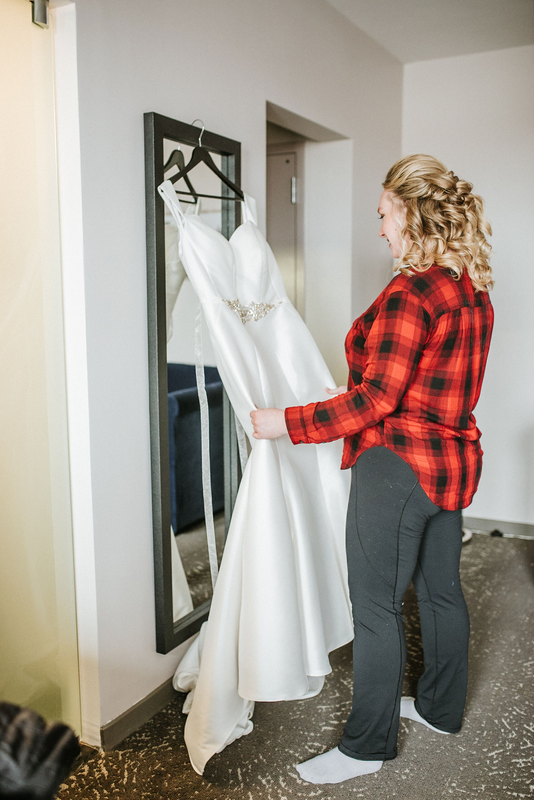 the bride admiring her wedding dress at the kimpton carlyle hotel
