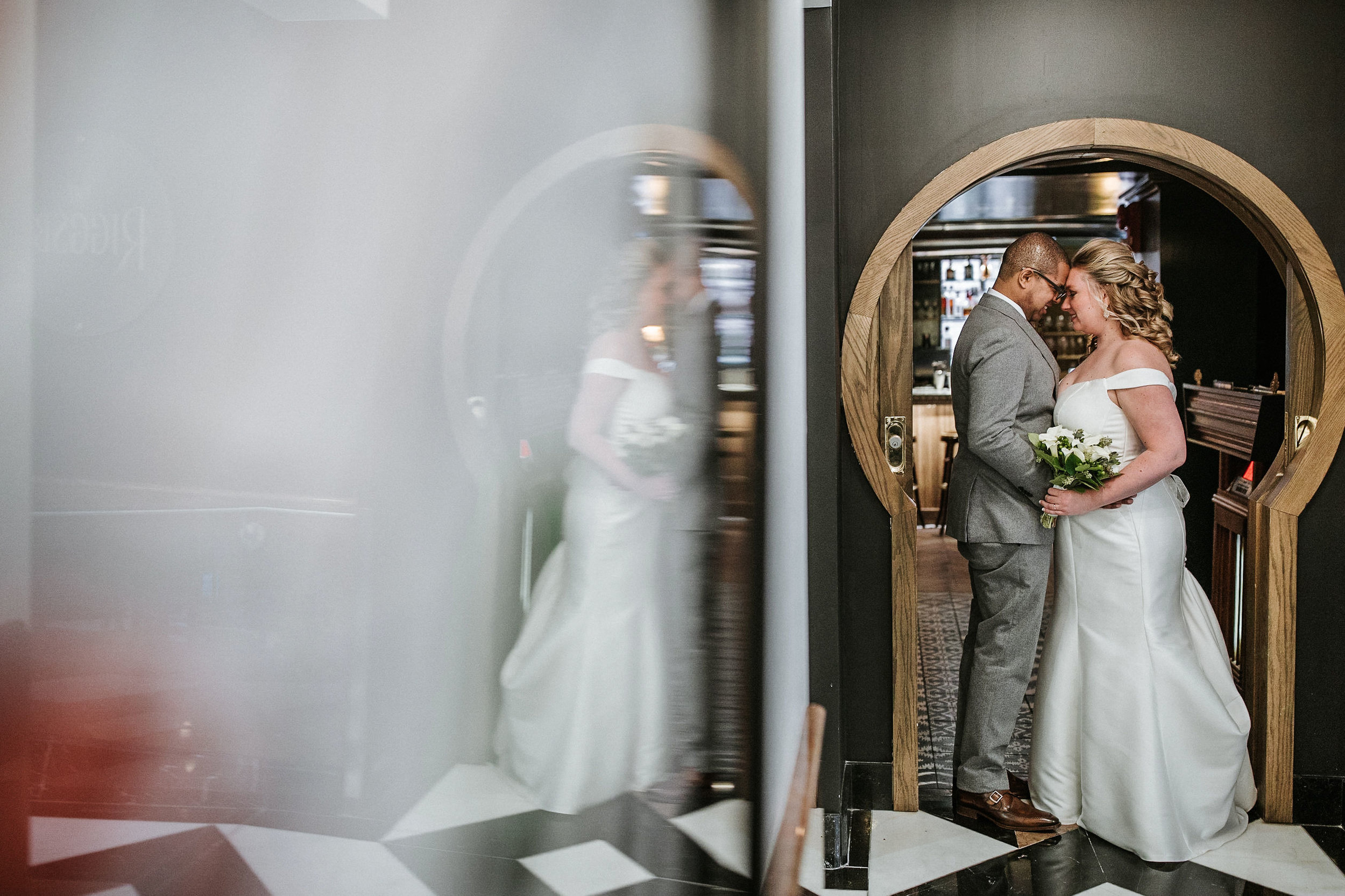 bride and groom embracing at the kimpton carlyle hotel