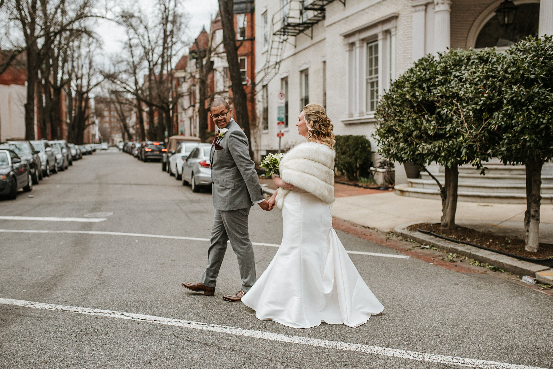 bride and groom holding hands at the josephine butler parks center