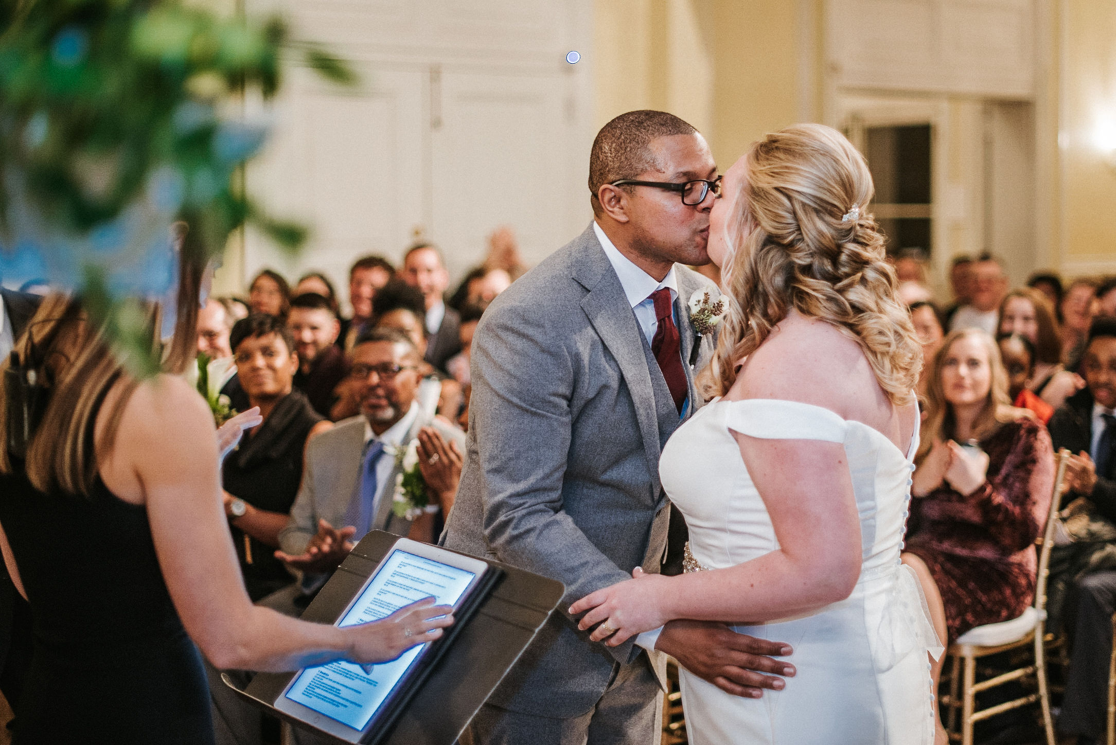 bride and groom kissing at the altar at the josephine butler parks center