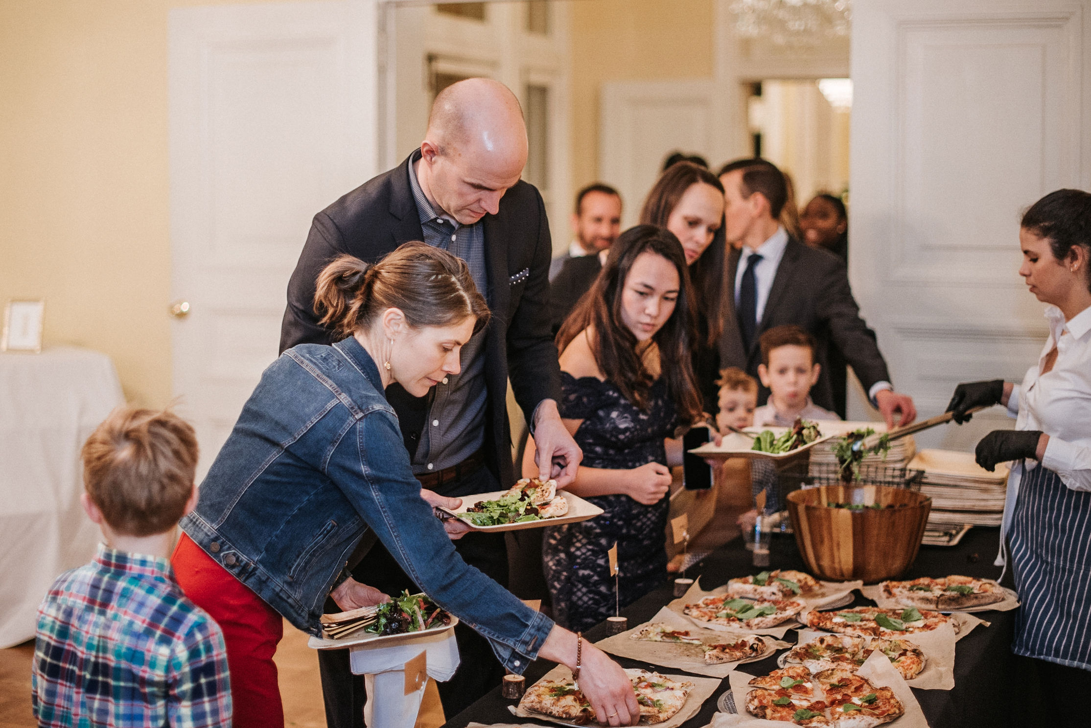 guests eating pizza at the josephine butler parks center