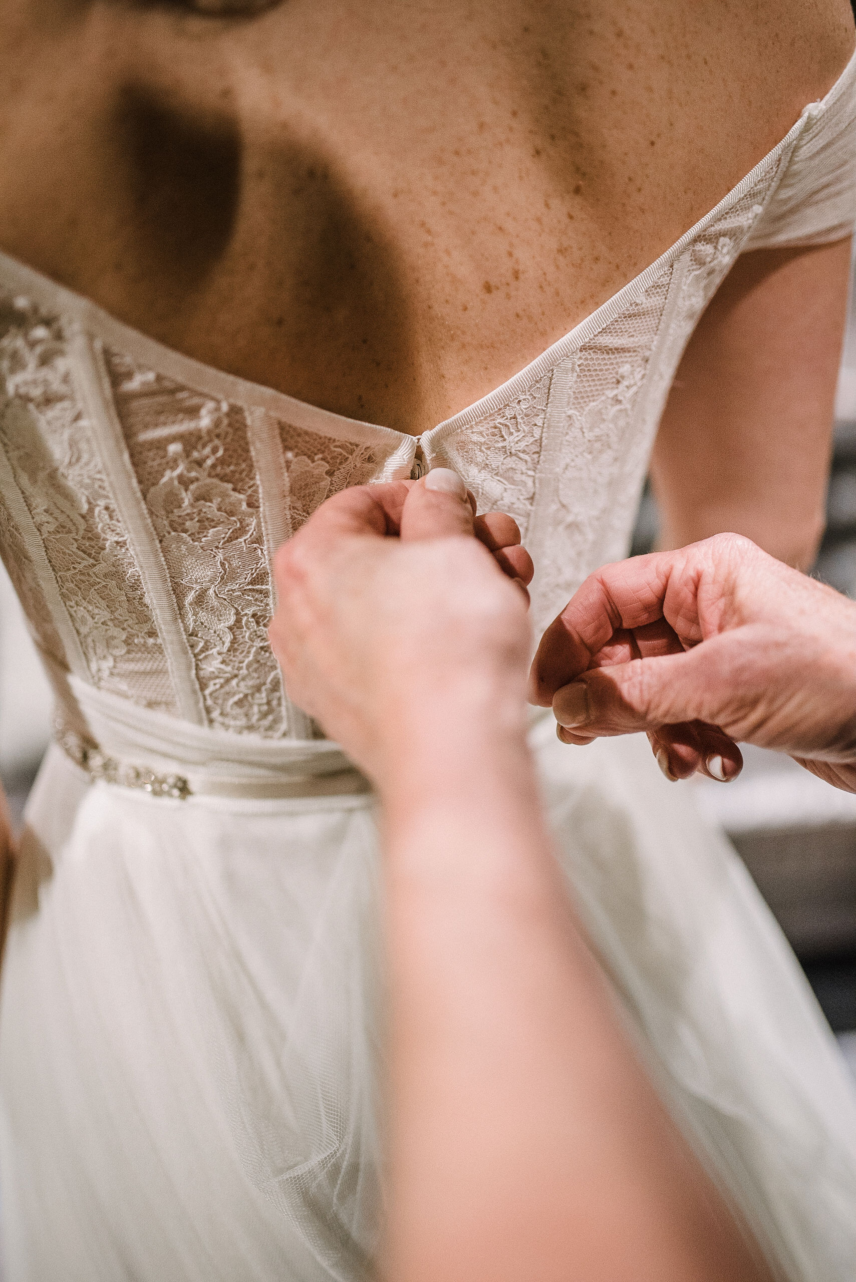 bride getting in to wedding dress at City Winery in Washington DC