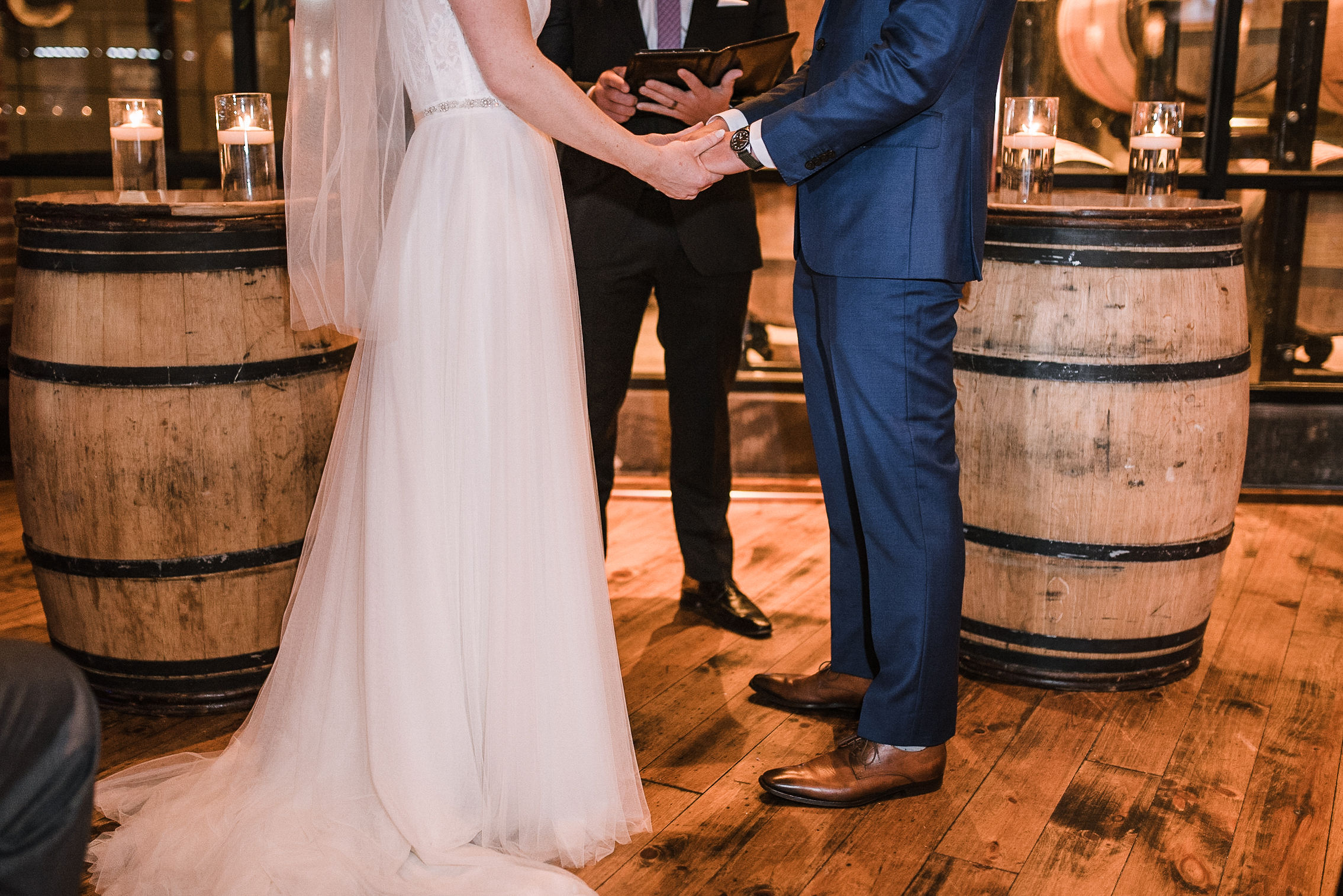 bride and groom holding hands at City Winery in Washington DC