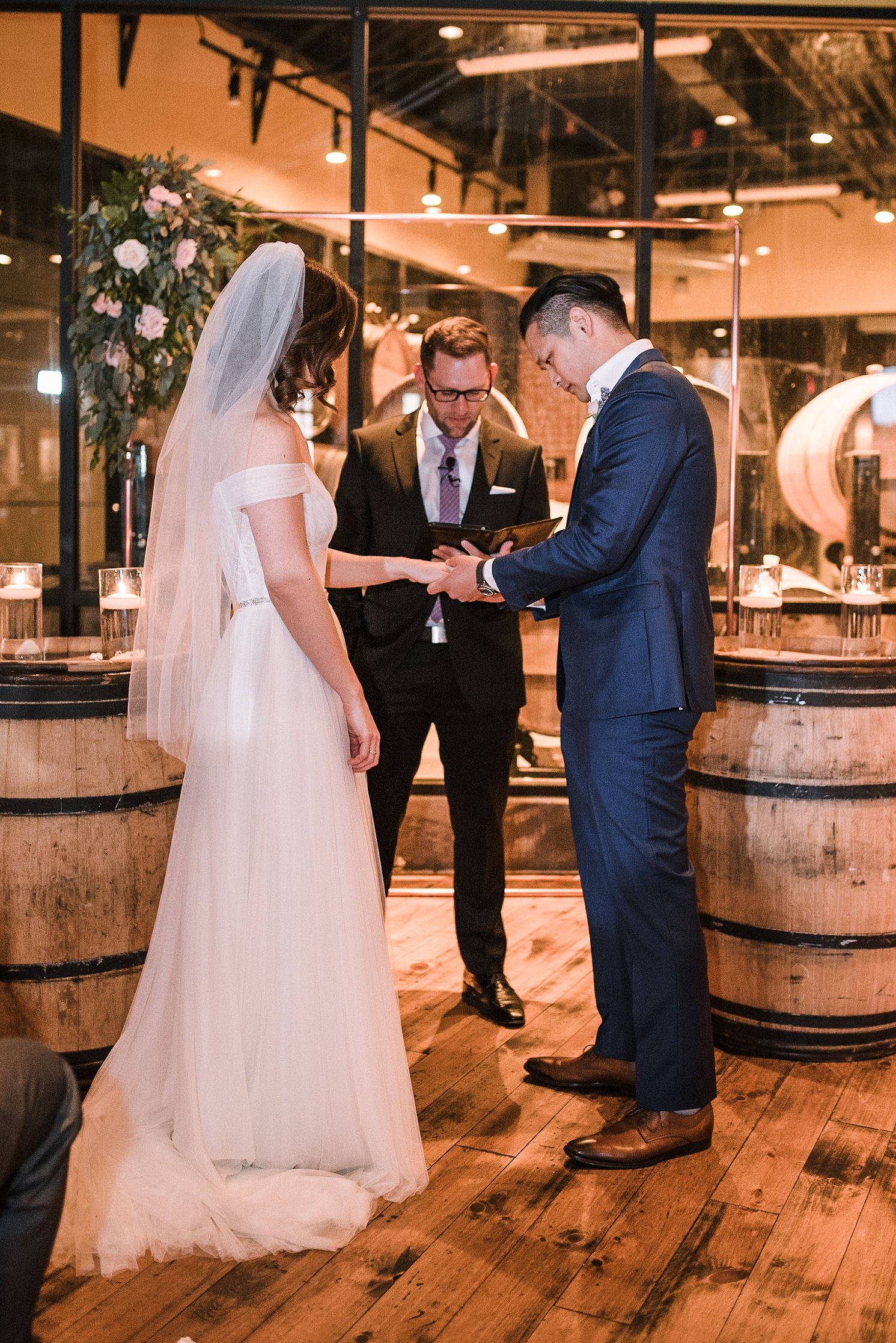 bride and groom exchanging rings at City Winery in Washington DC