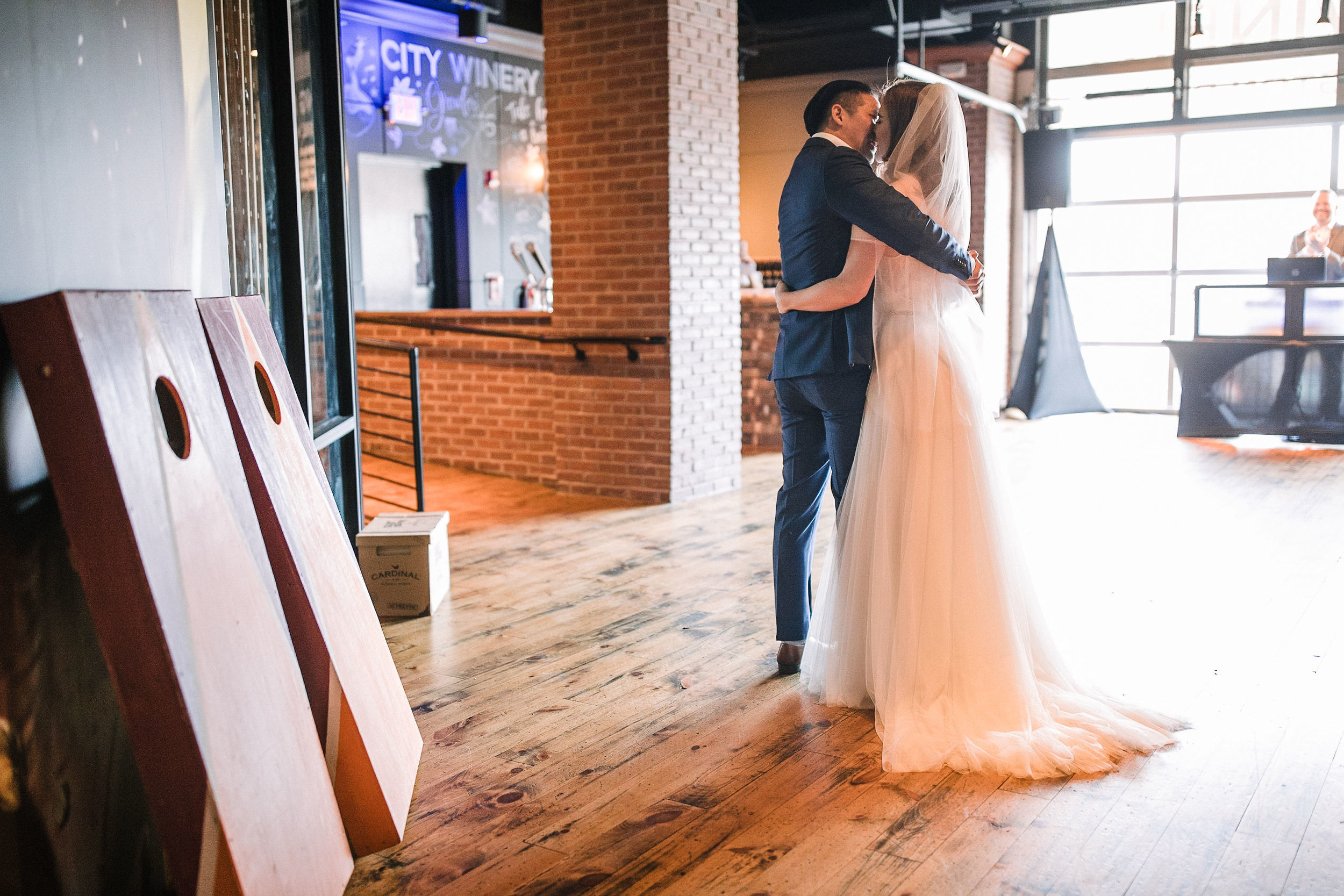 bride and groom kissing at City Winery in Washington DC