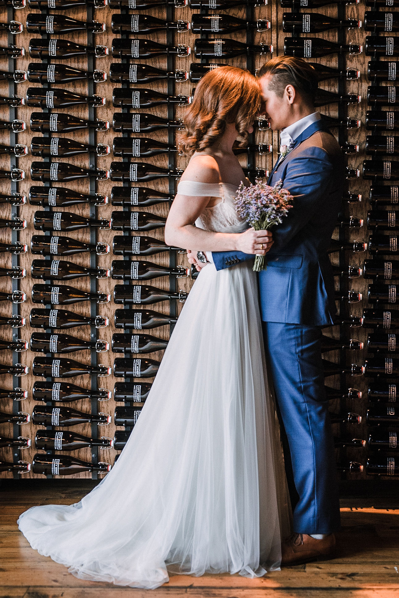 bride and groom embracing at City Winery in Washington DC