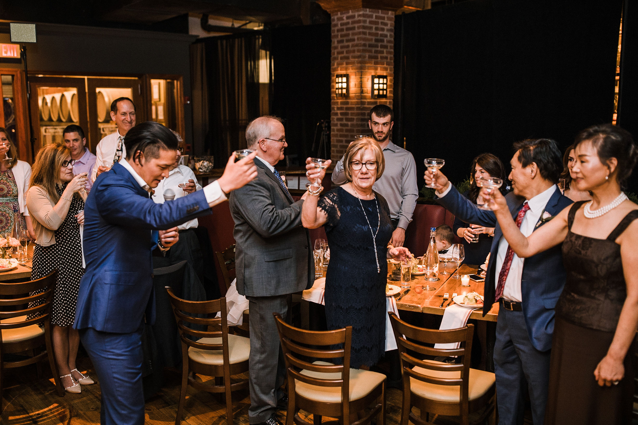 guests toasting at wedding reception at City Winery in Washington DC