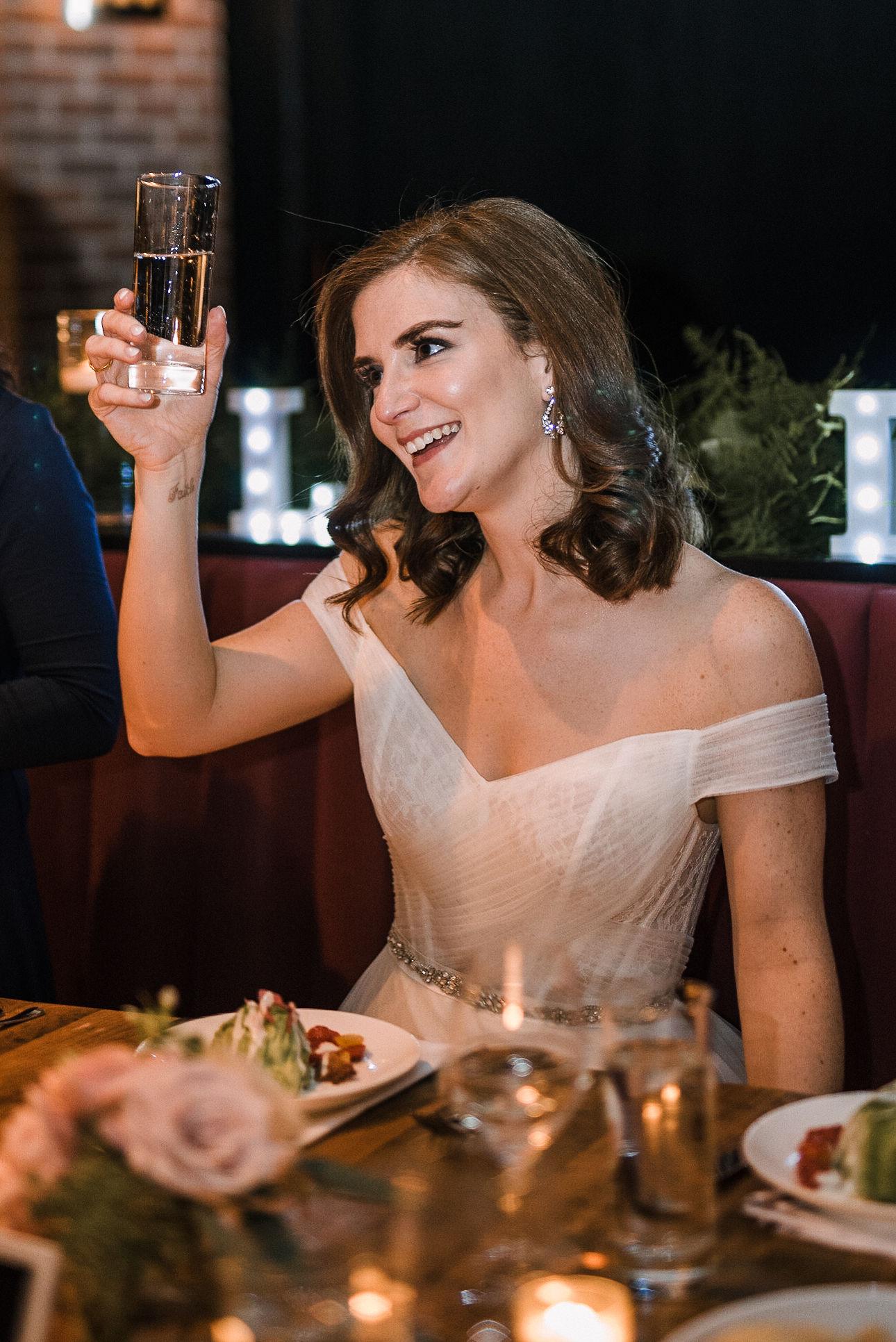 bride toasting at wedding reception at City Winery in Washington DC