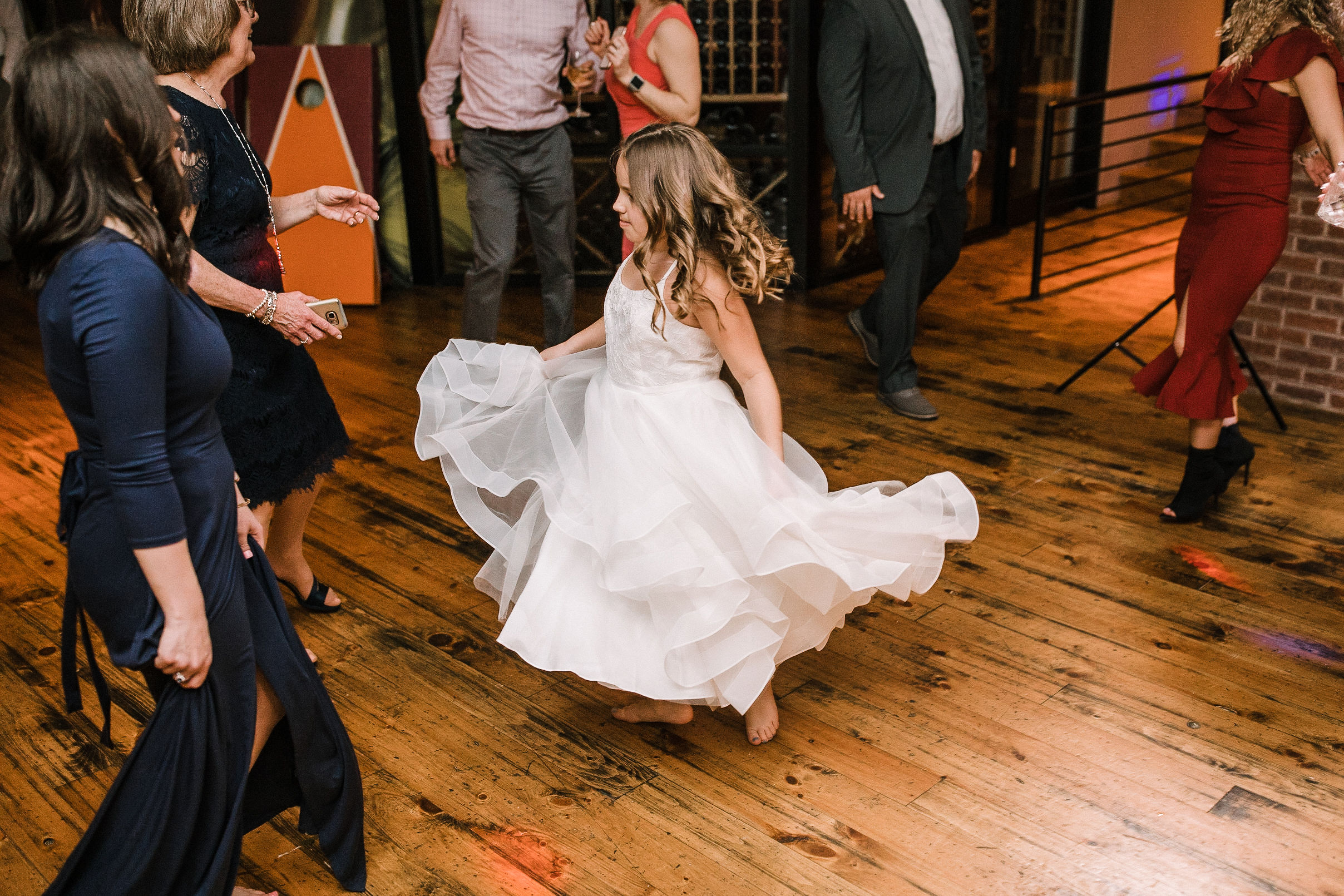 flower girl dancing at reception at City Winery in Washington DC