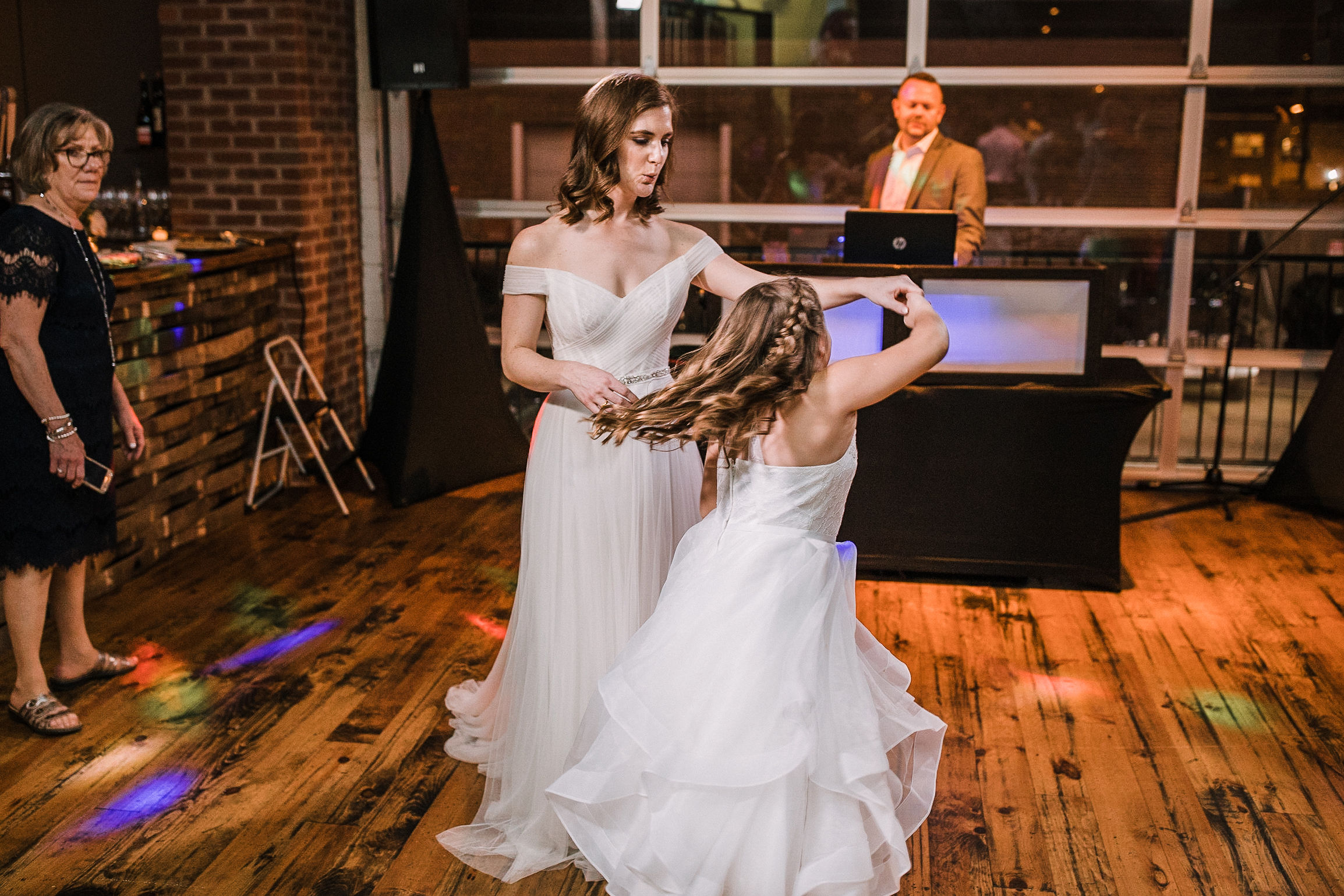 bride and flower girl dancing at reception at City Winery in Washington DC