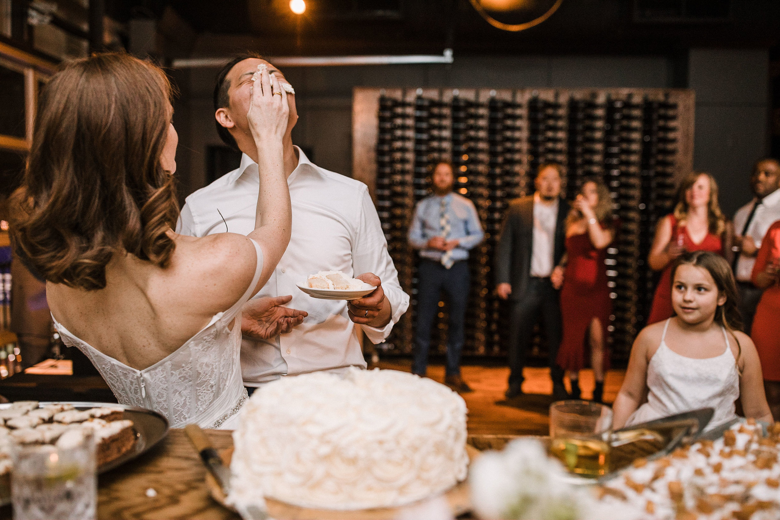 bride and groom eating wedding cake at City Winery in Washington DC