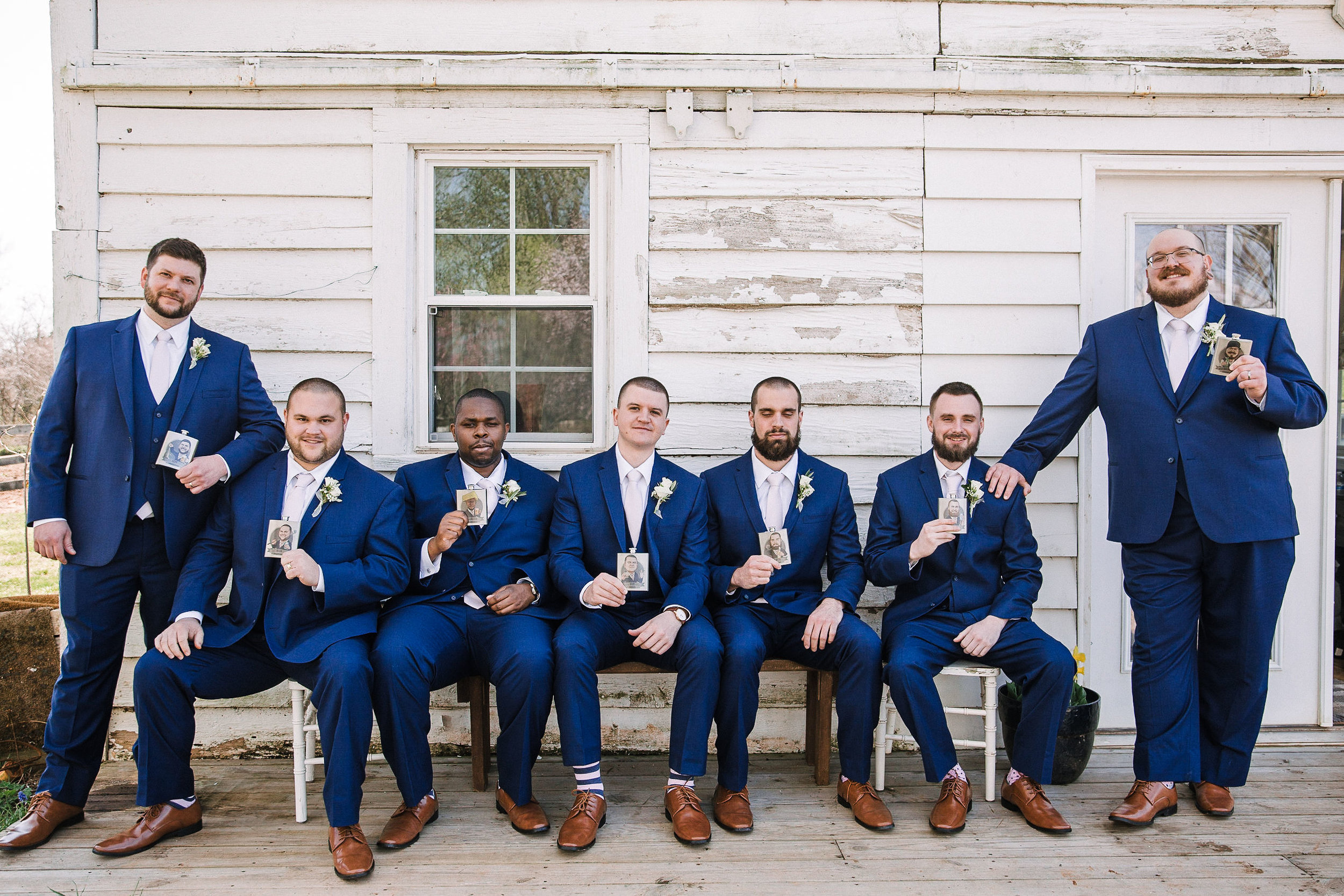 Groom and groomsmen posing with flasks at Rixey Manor