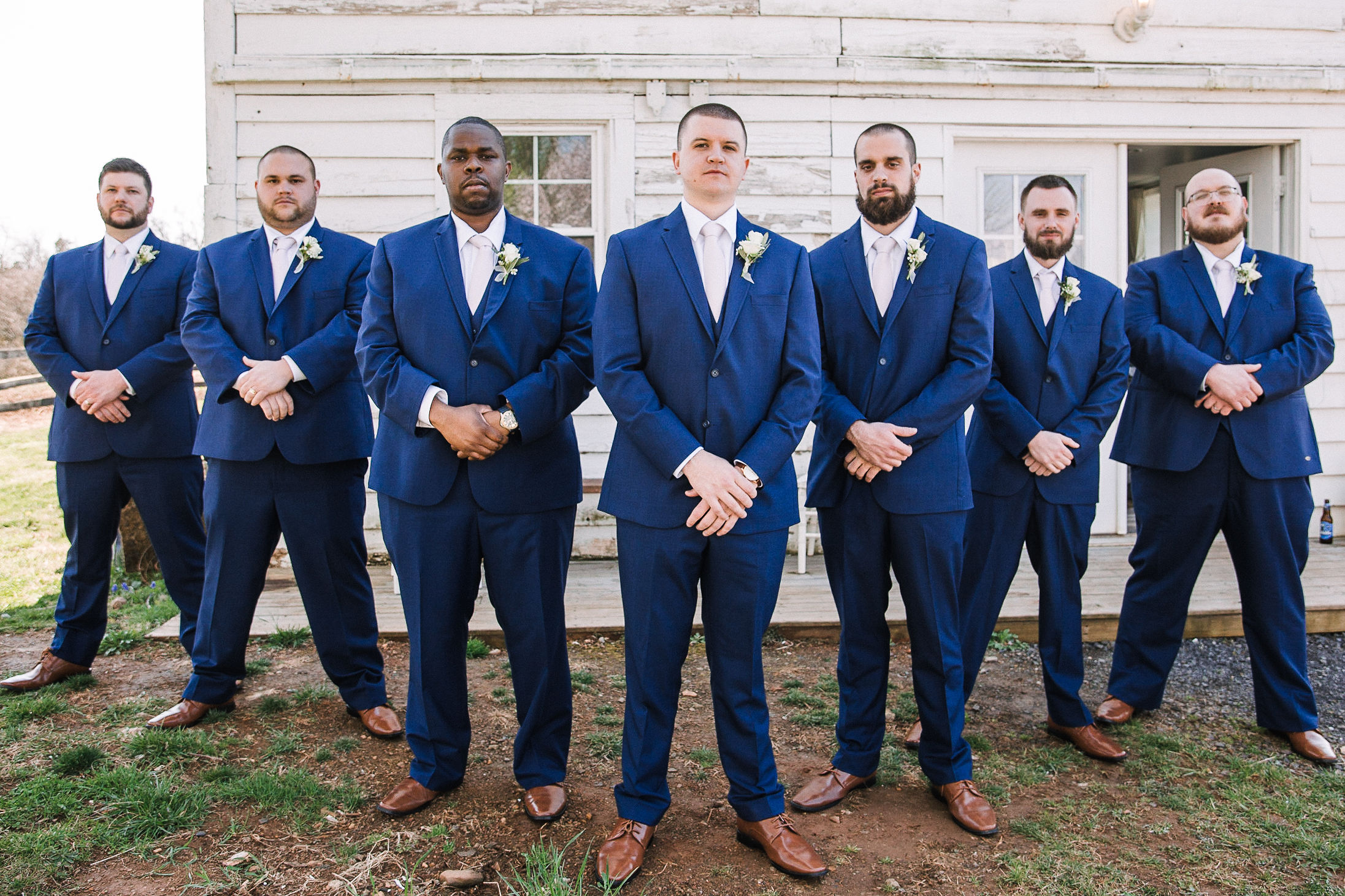 Groom and groomsmen posing at Rixey Manor