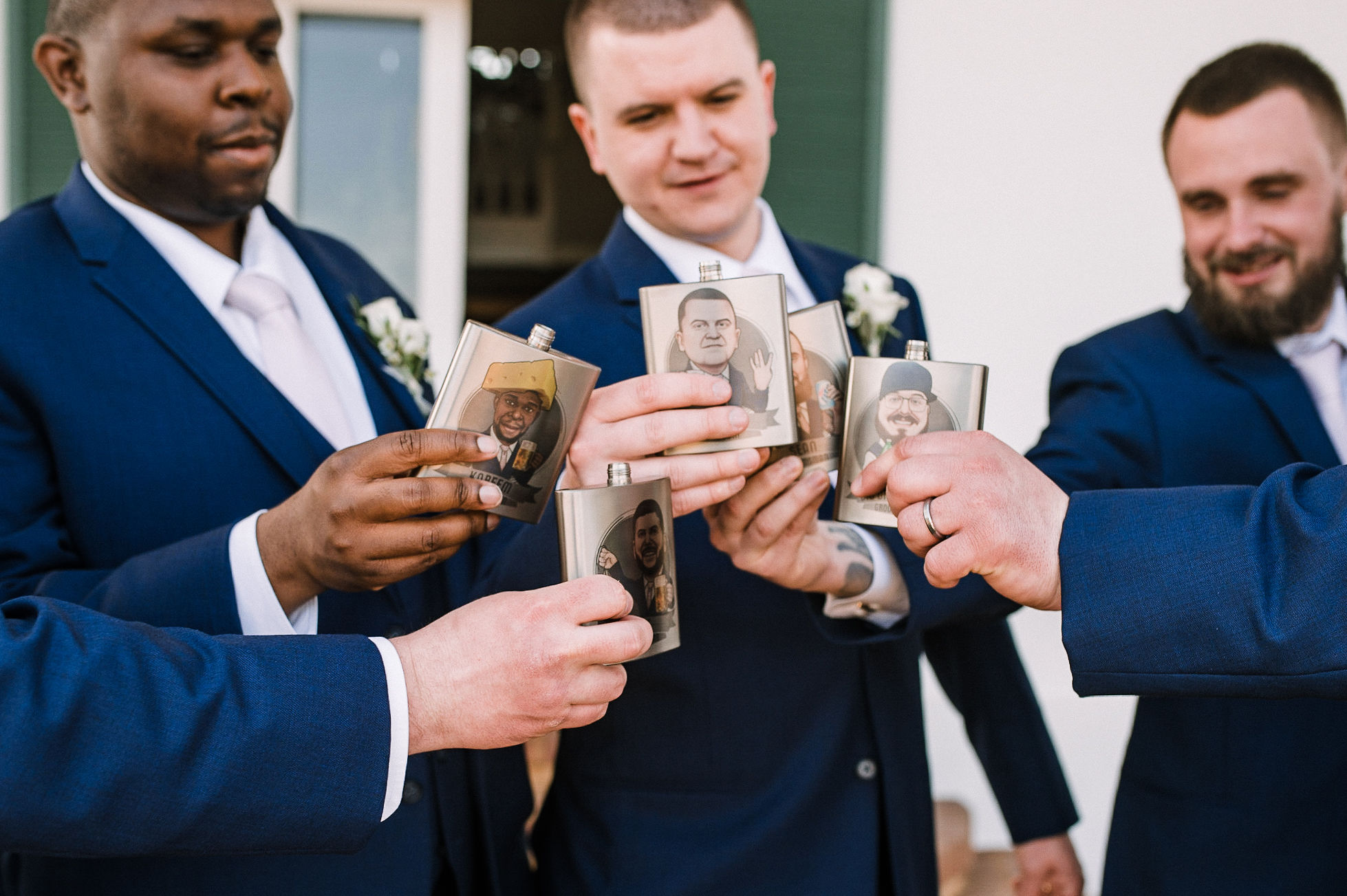 Groom and groomsmen cheering flasks at Rixey Manor