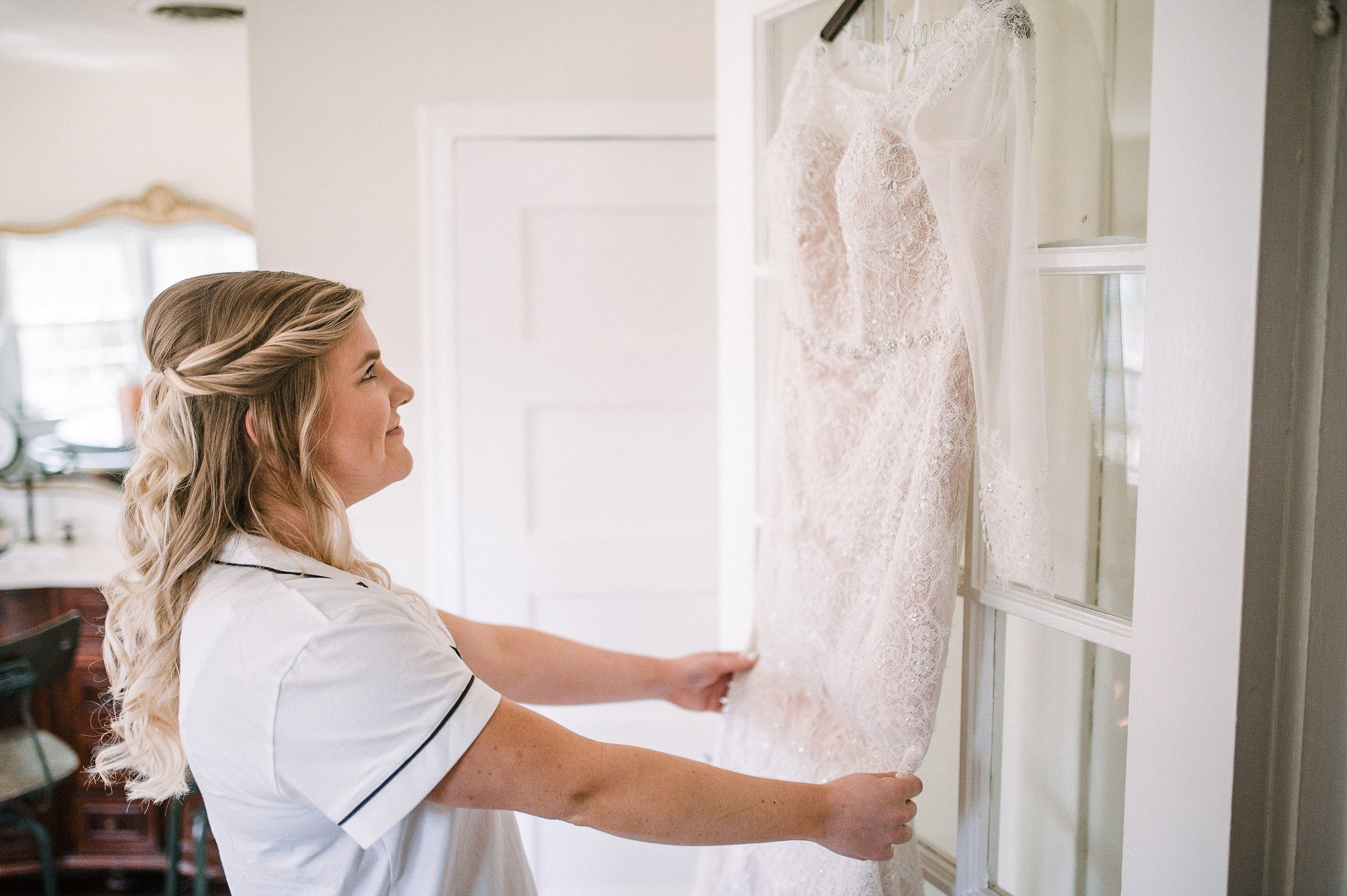 bride looking at wedding dress at Rixey Manor