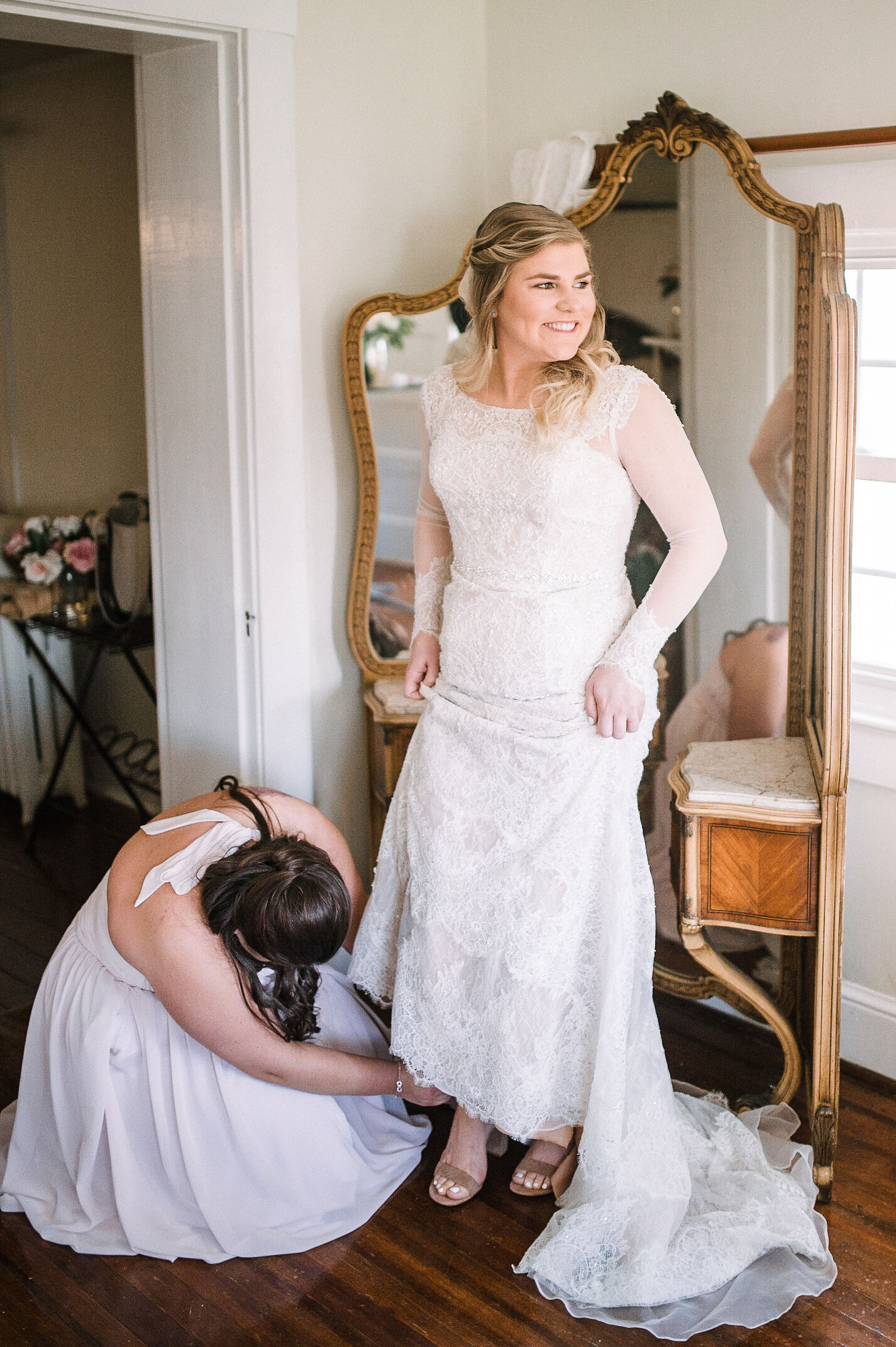 bride putting on shoes at Rixey Manor