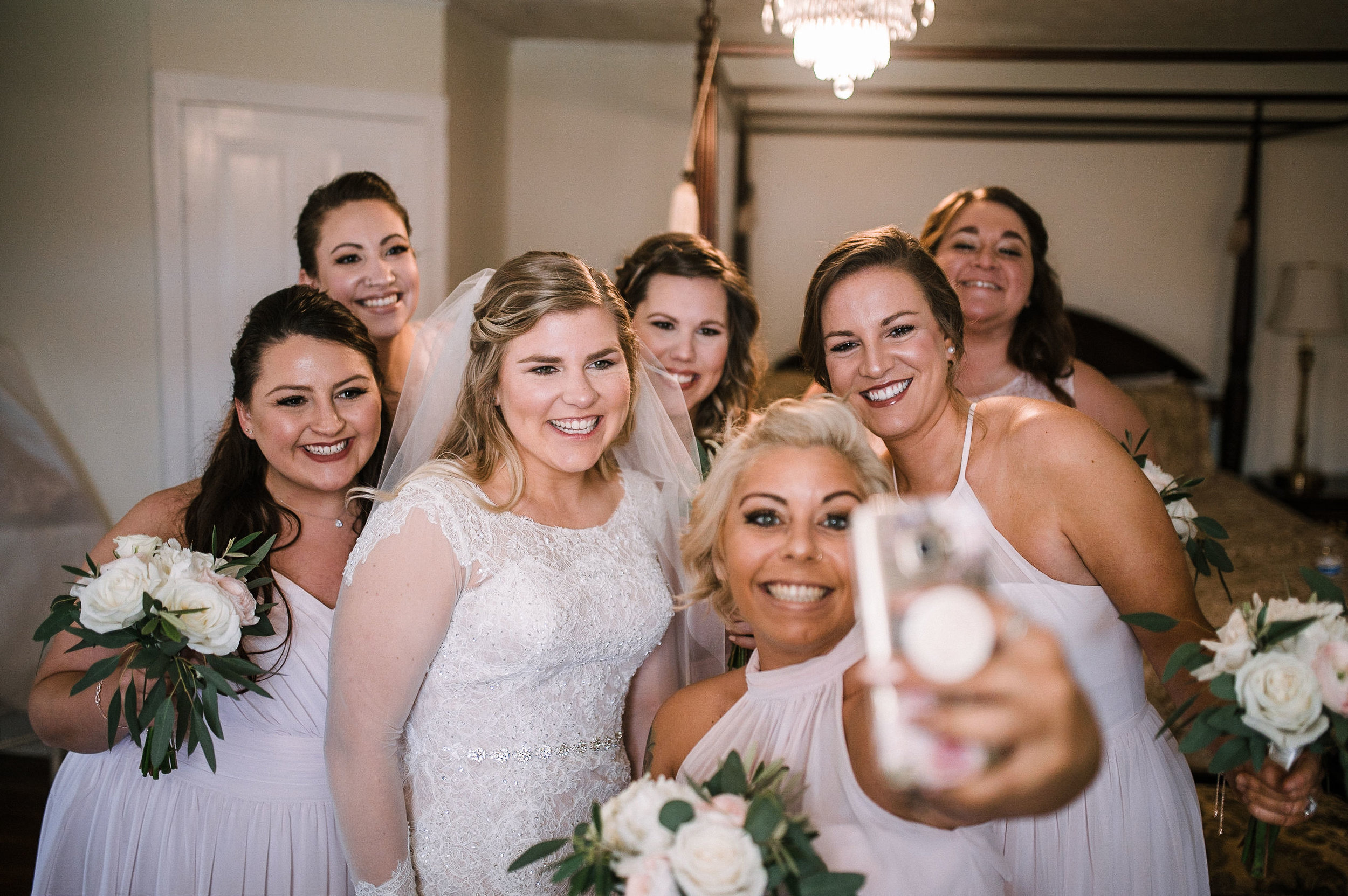 bride and bridesmaids taking a selfie at Rixey Manor