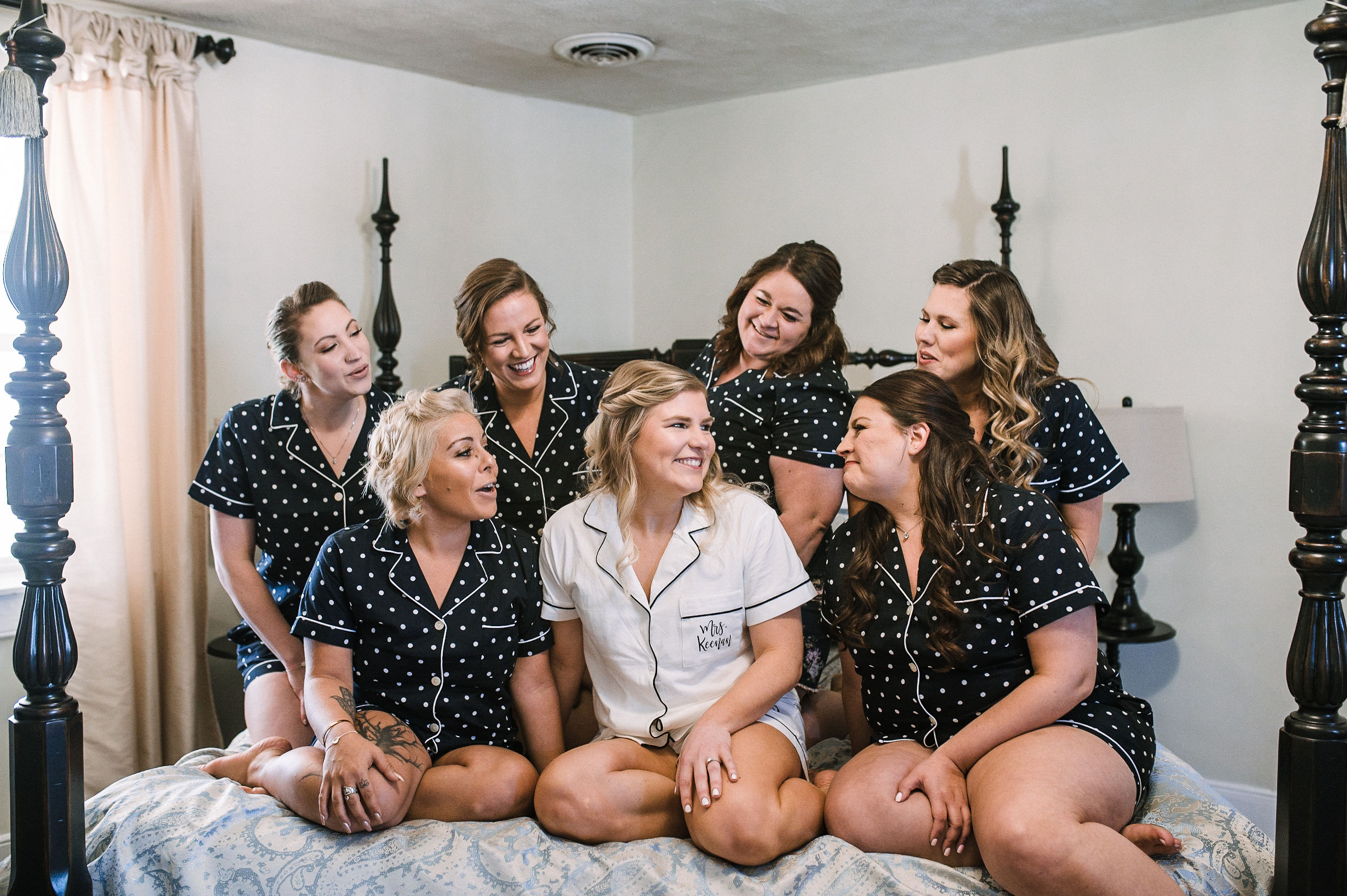 bride and bridesmaids smiling at Rixey Manor