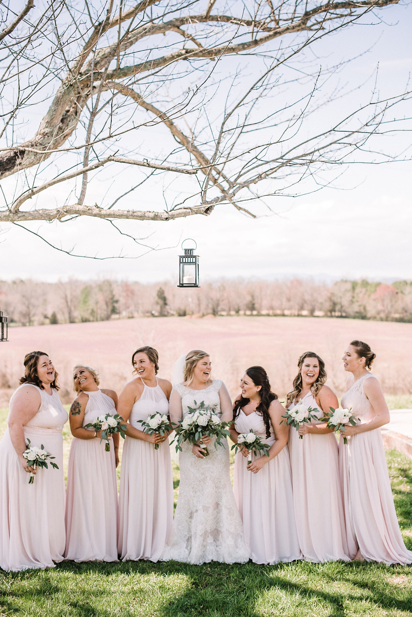 bride and bridesmaids posing at Rixey Manor