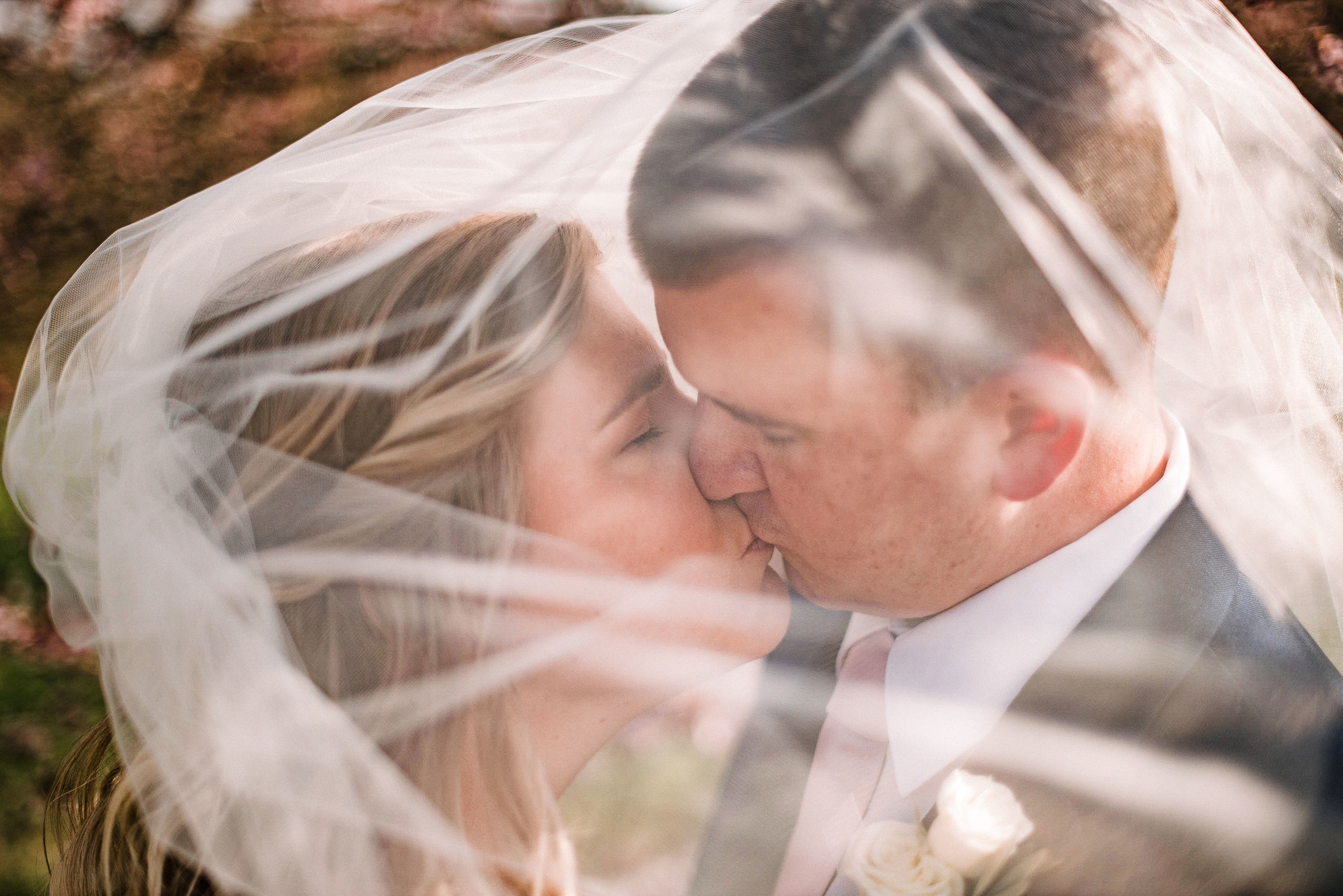 bride and groom kissing under veil at Rixey Manor