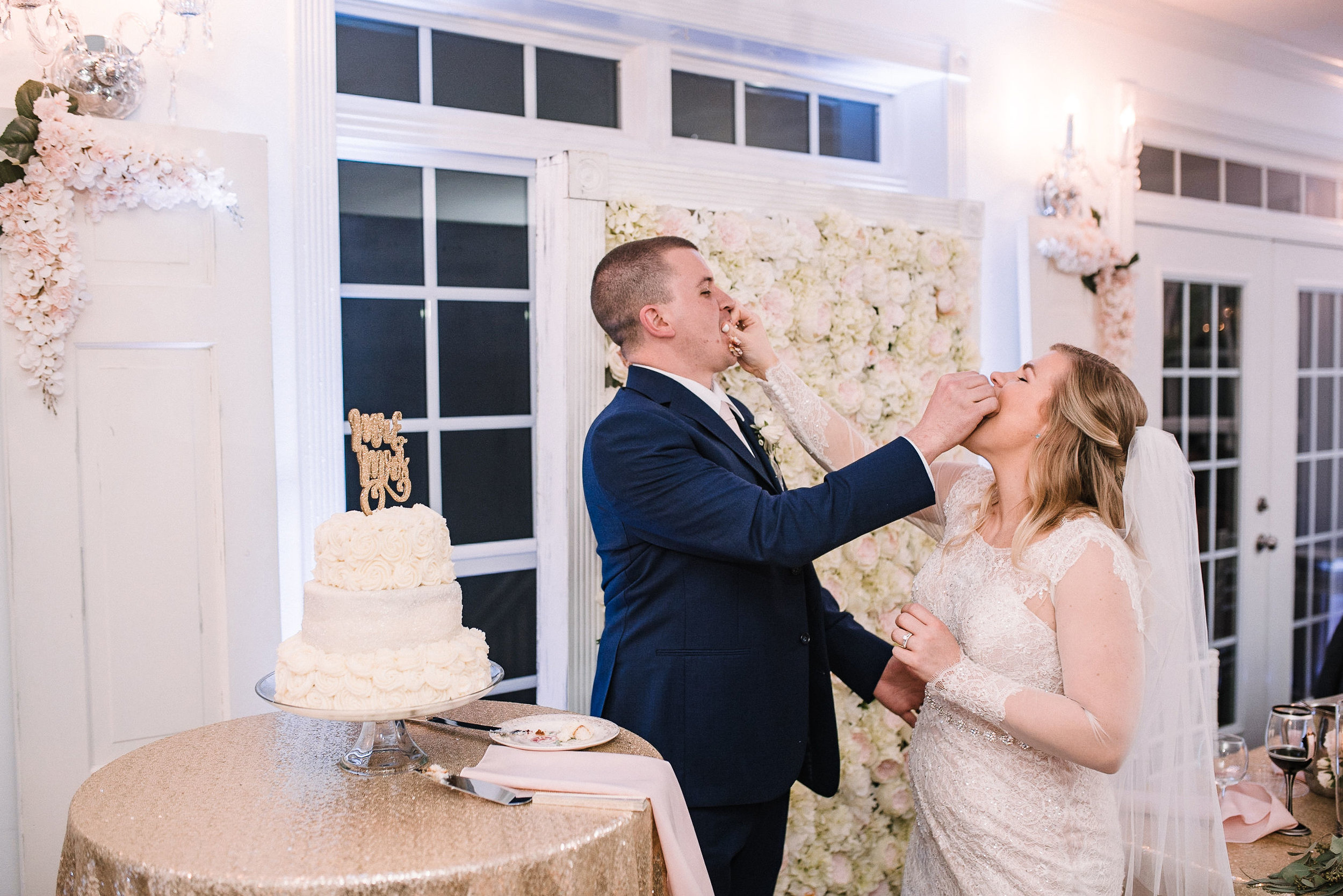 bride and groom cutting cake at Rixey Manor