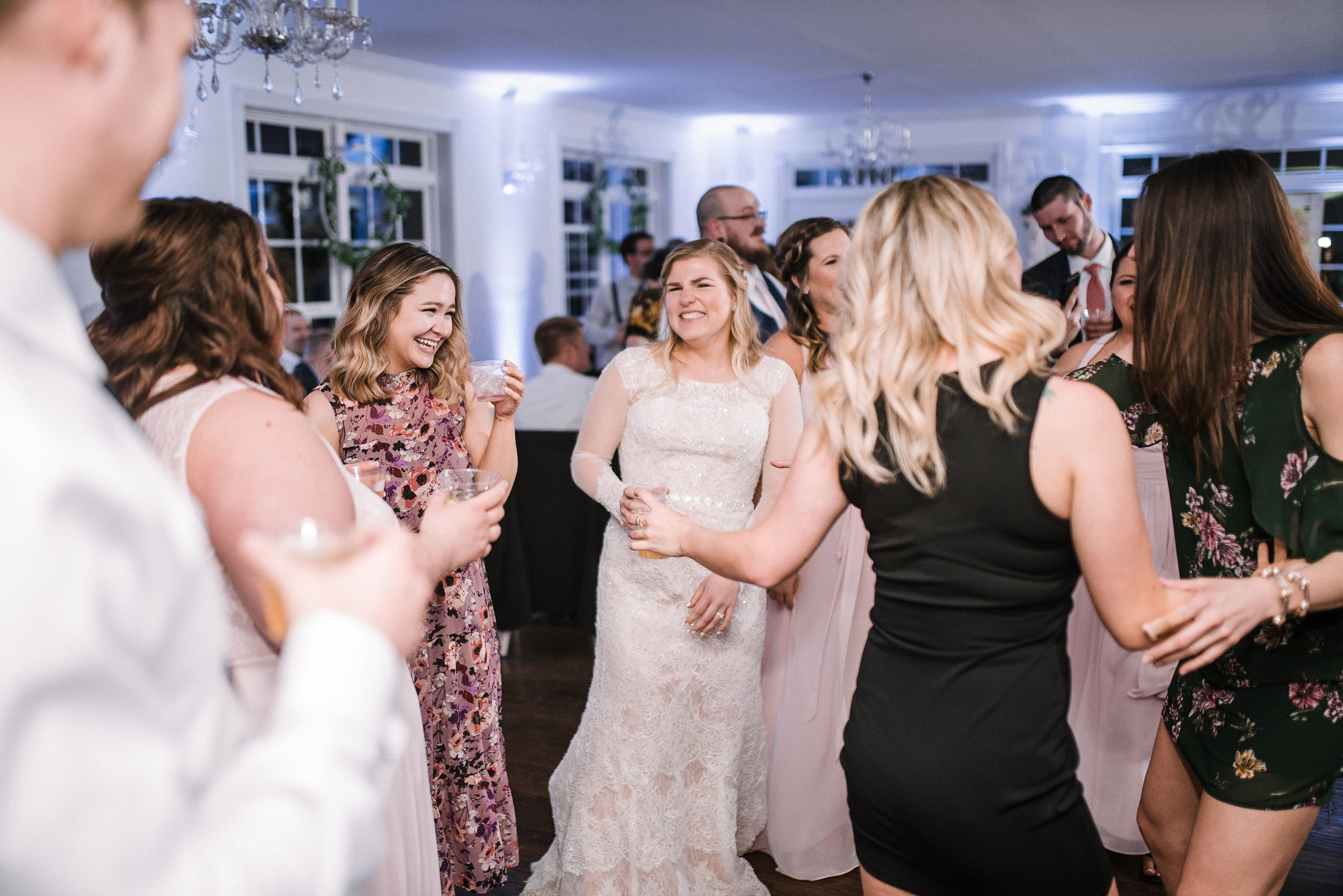 bride and guests dancing at reception at Rixey Manor