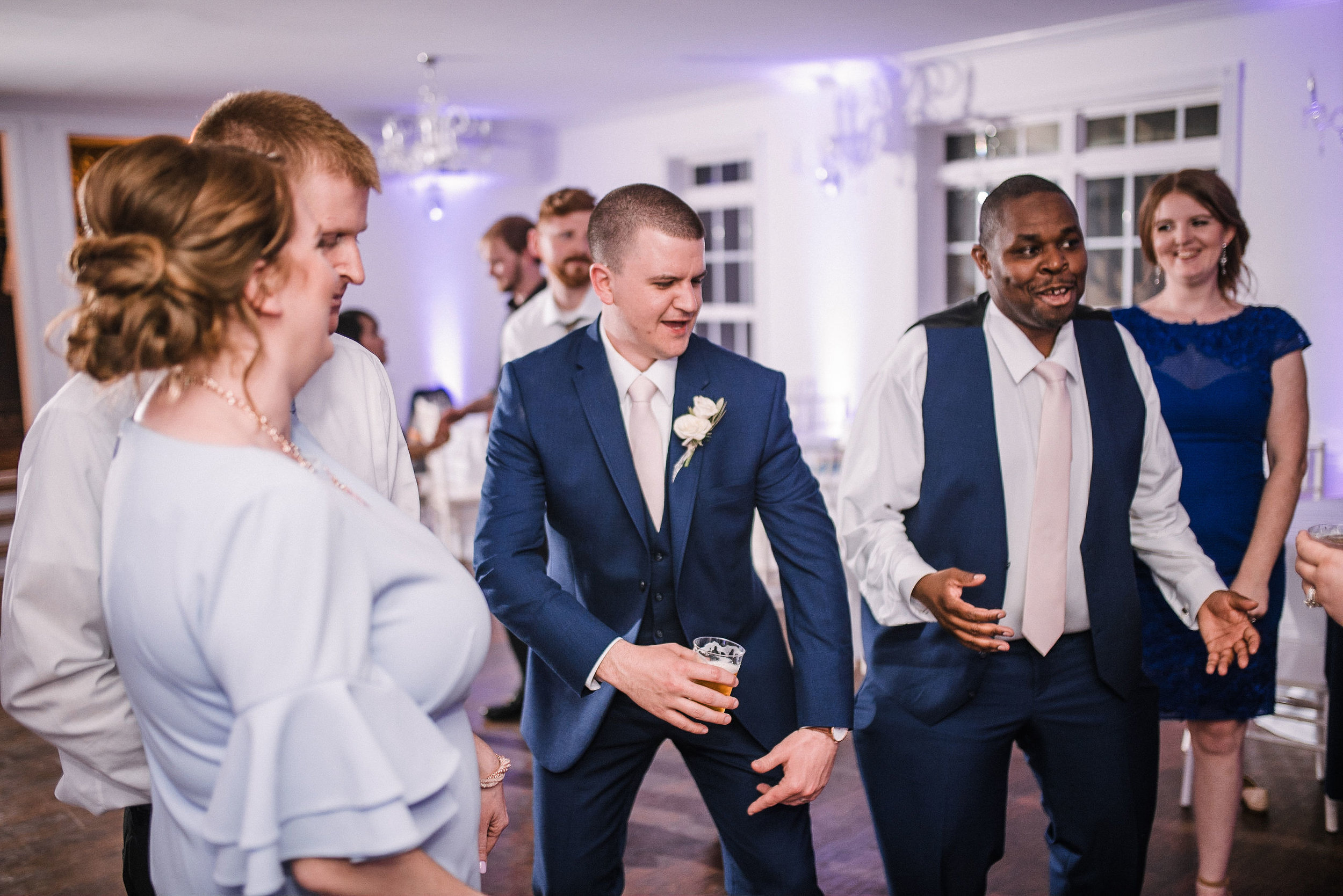 groom dancing at reception at Rixey Manor