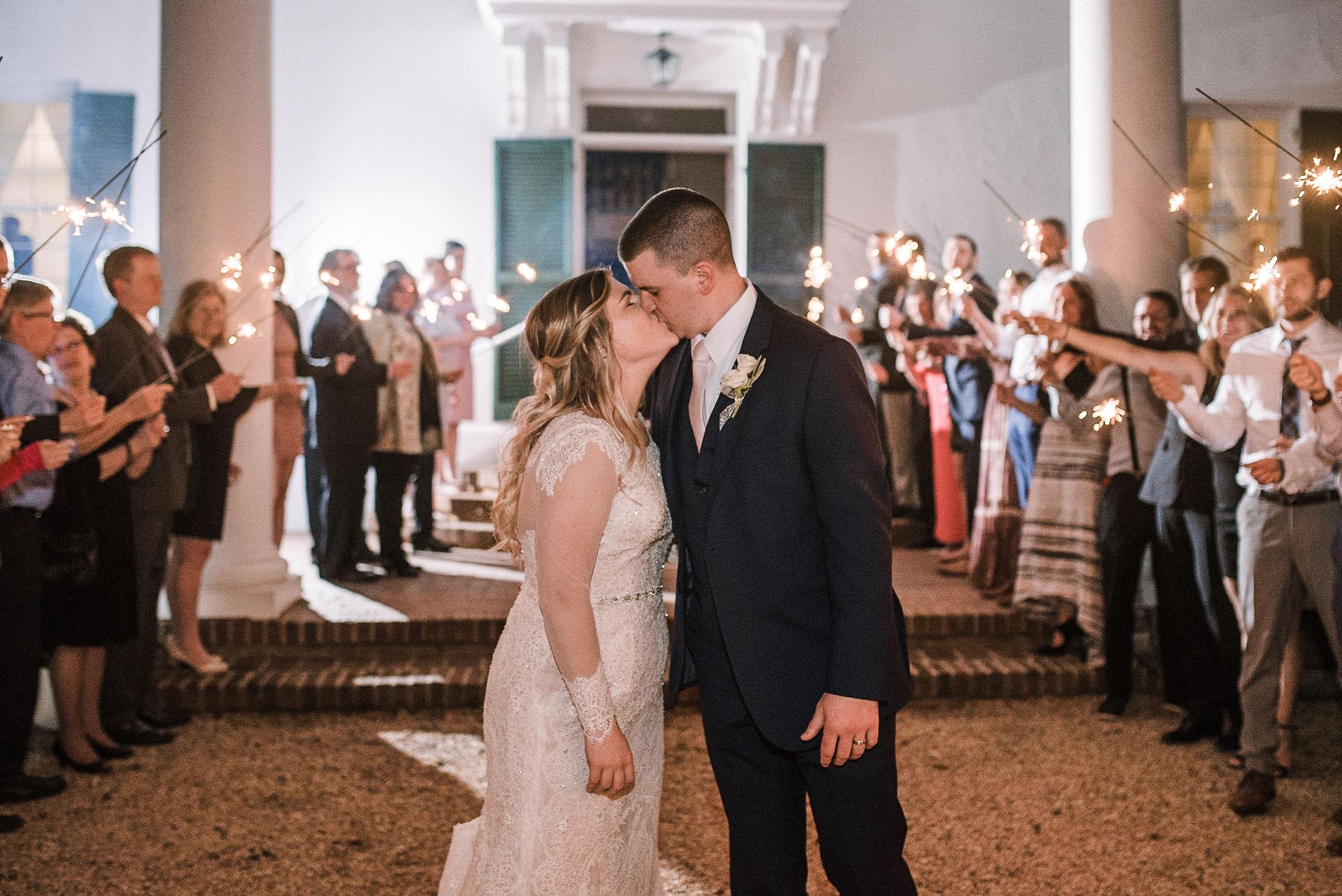 bride and groom kissing at Rixey Manor