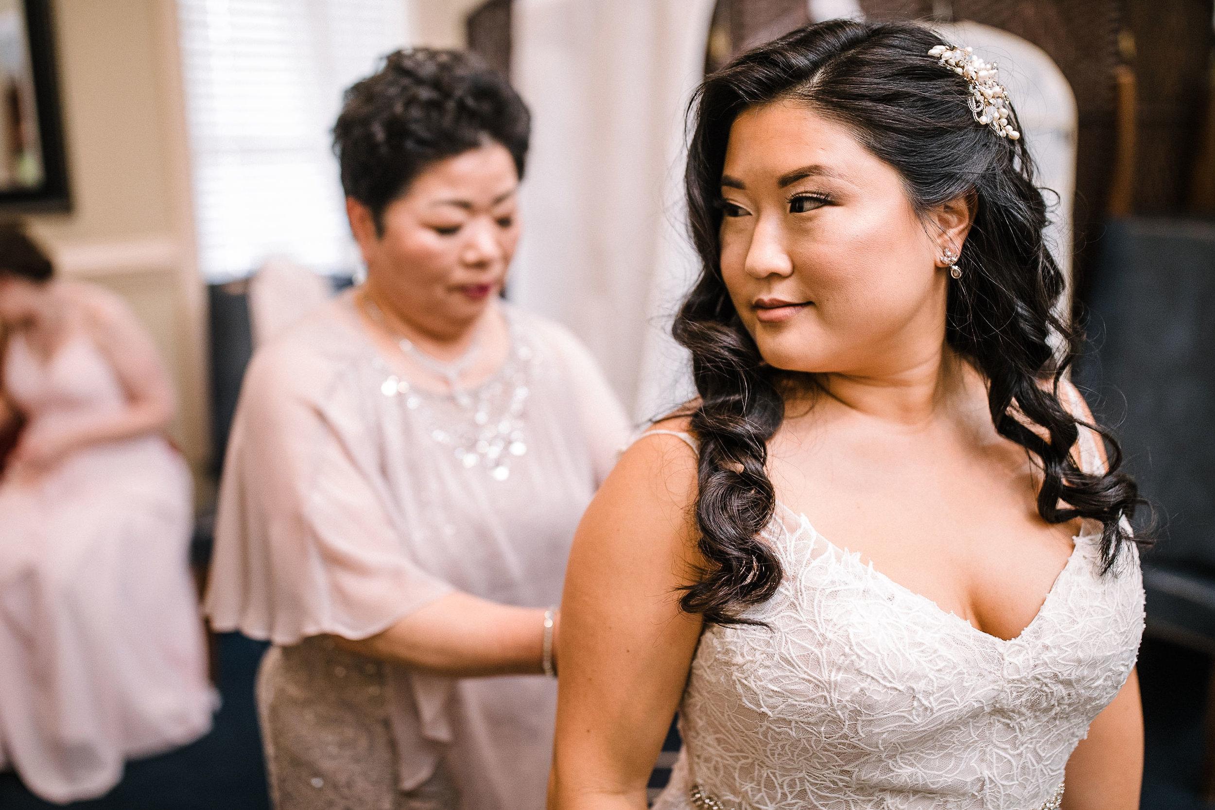 bride getting into wedding dress at Westfields Golf Club