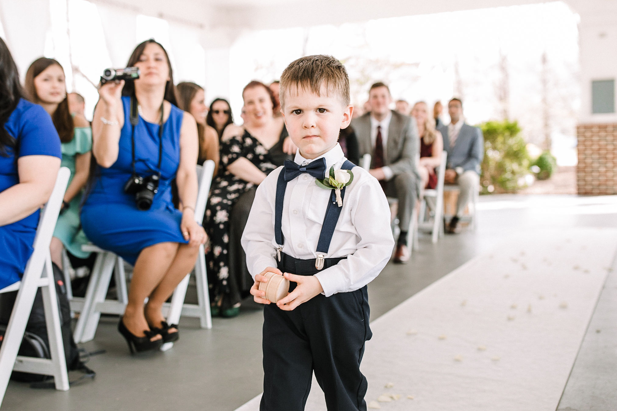 ring bearer coming down the aisle at Westfields Golf Club