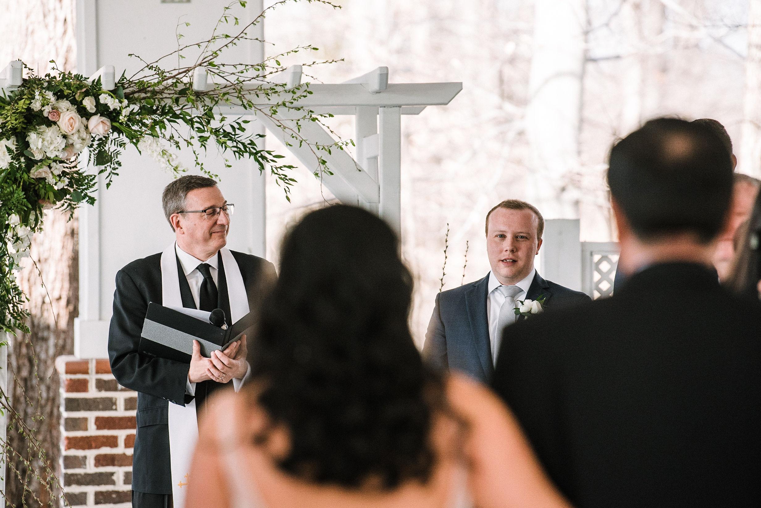 groom seeing bride walk down the aisle at Westfields Golf Club