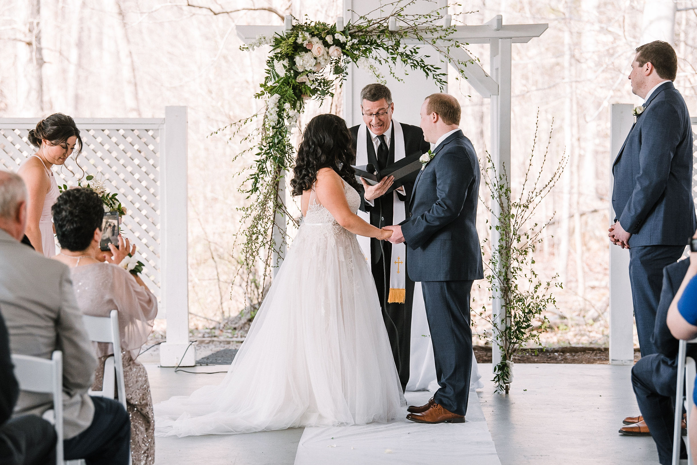 bride and groom holding hands at the altar at Westfields Golf Club