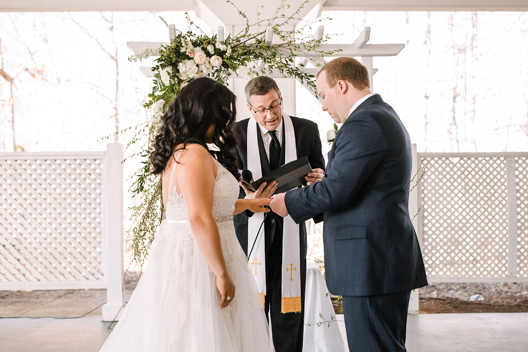 bride and groom exchanging wedding rings at Westfields Golf Club