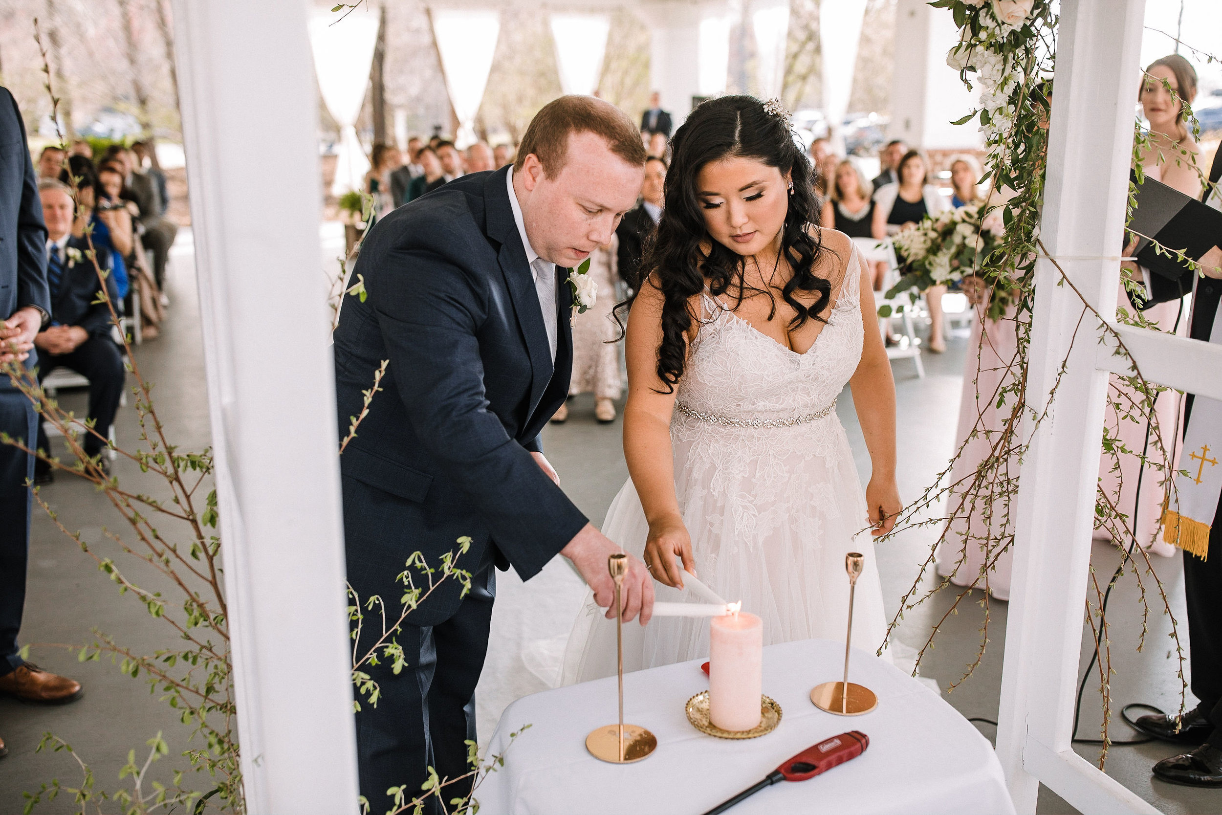 bride and groom lighting candle at ceremony at Westfields Golf Club