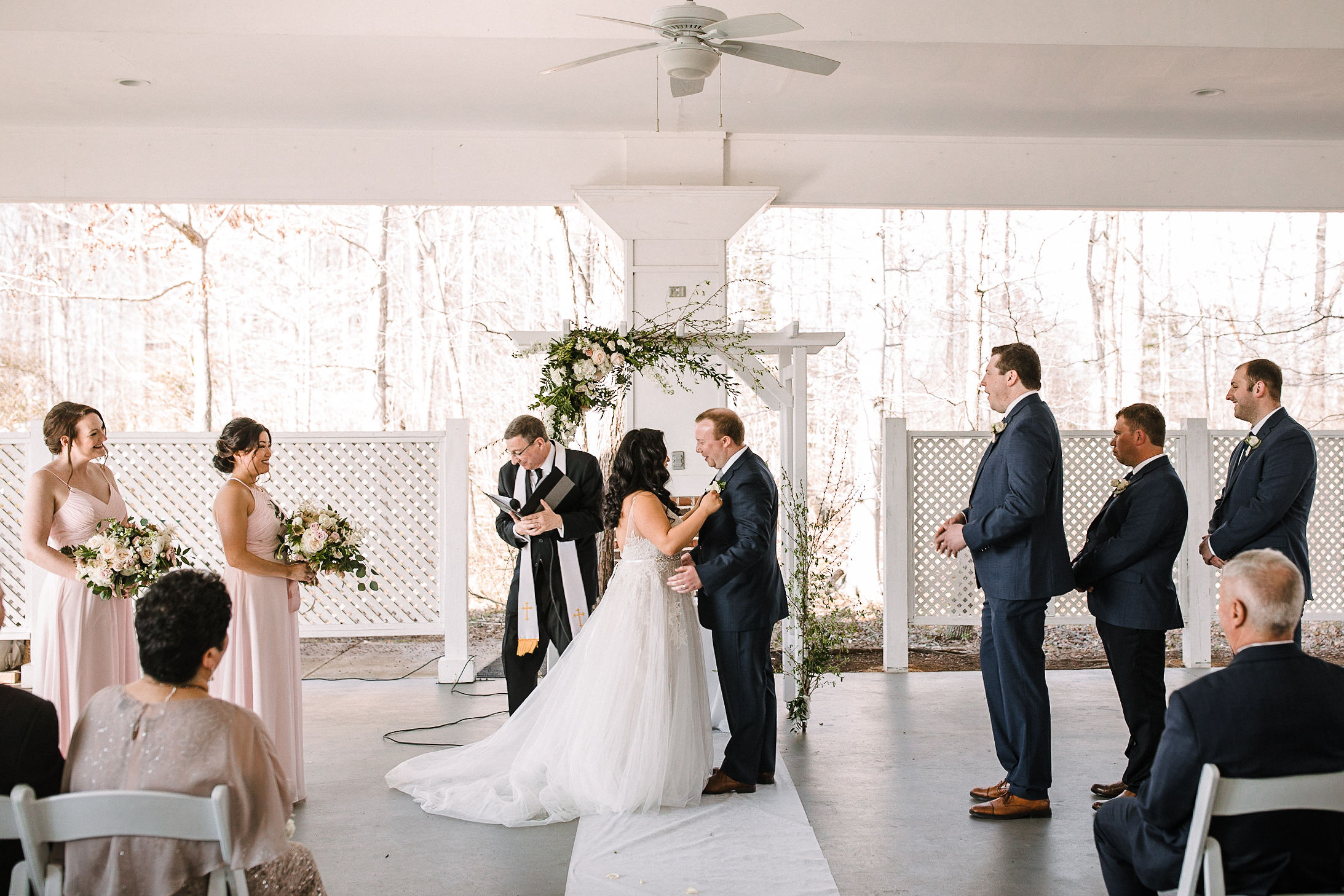 bride and groom holding hands at altar at Westfields Golf Club