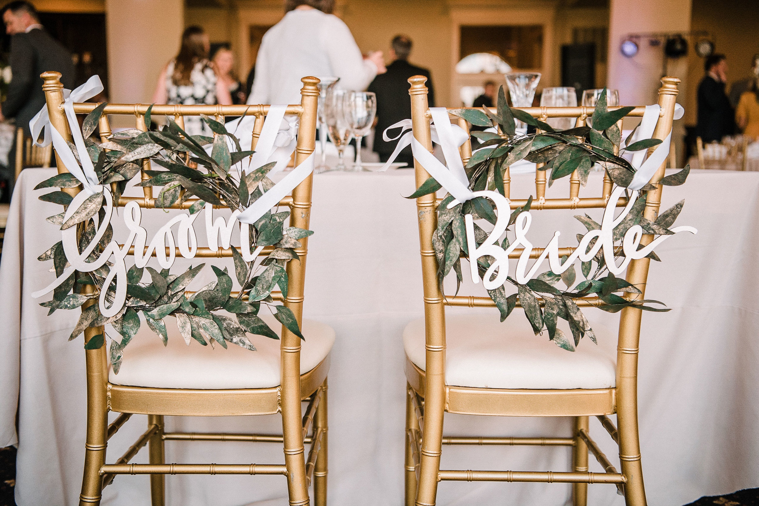 groom and bride chairs at reception at Westfields Golf Club