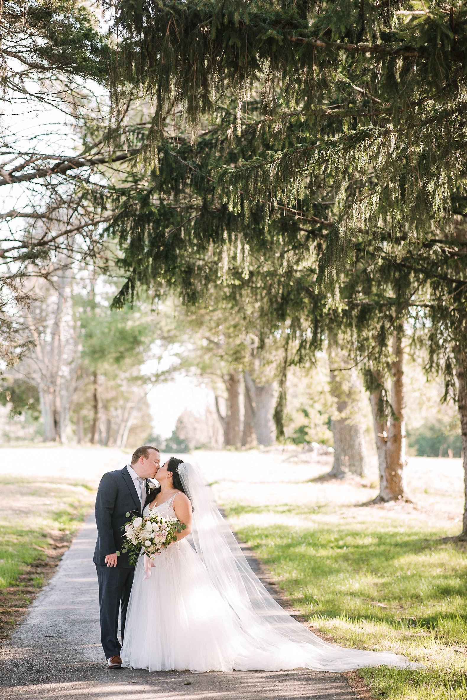 bride and groom kissing at Westfields Golf Club