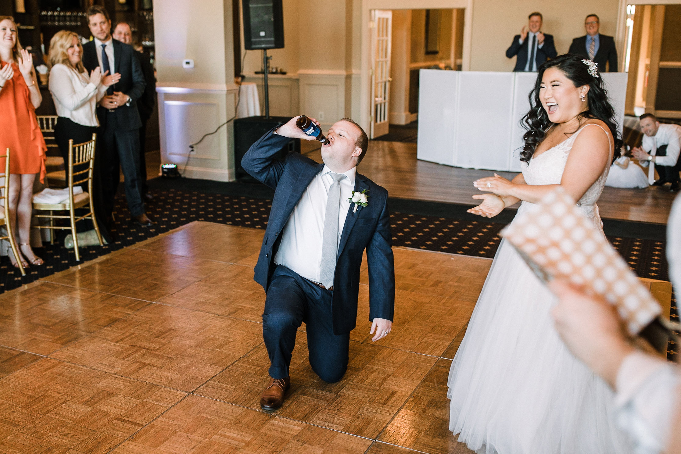 groom drinks beer at reception at Westfields Golf Club