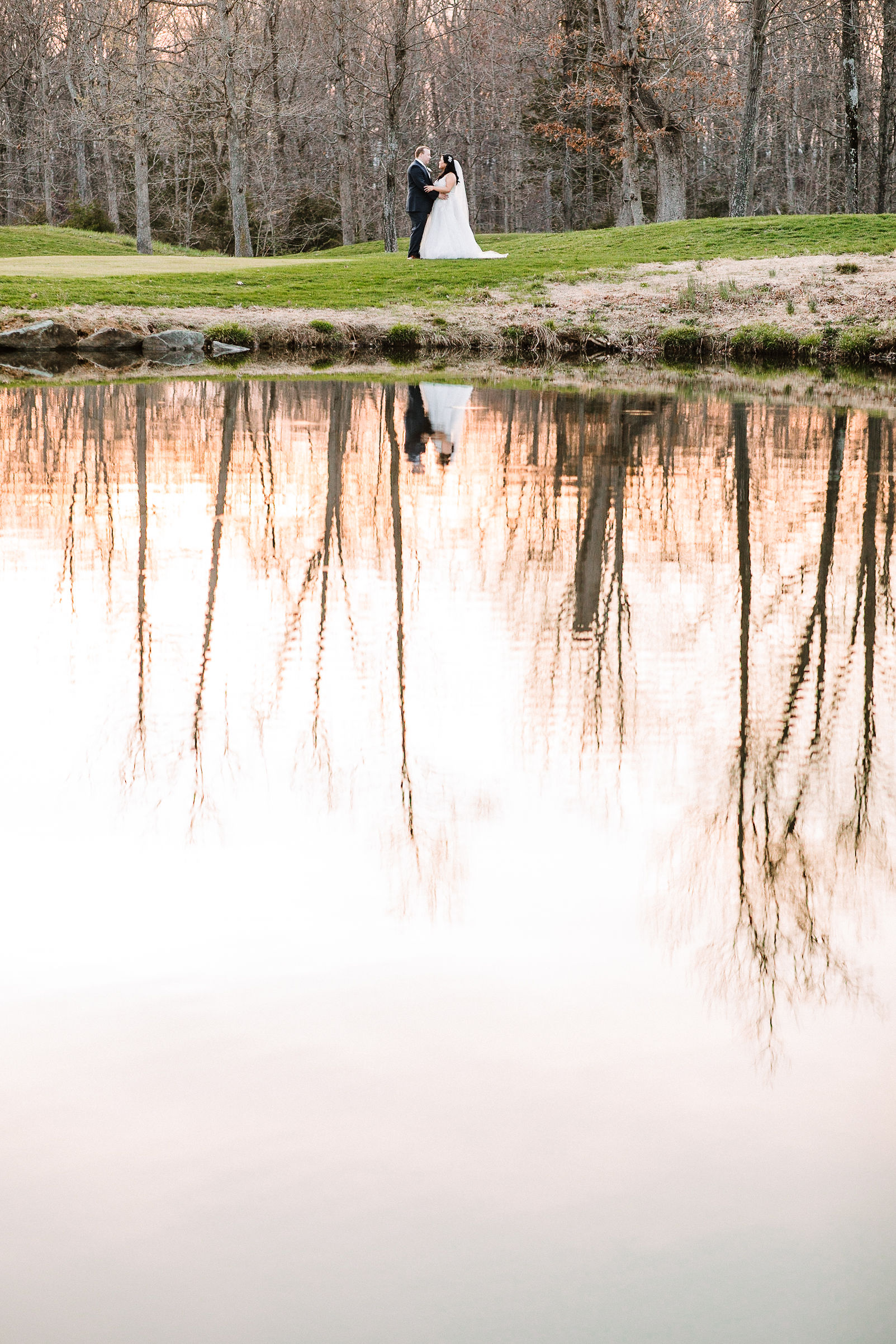 bride and groom reflection in water at Westfields Golf Club