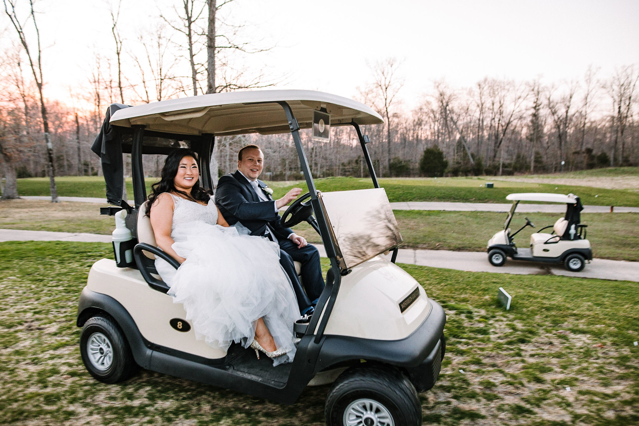 bride and groom ride in golf course at Westfields Golf Club