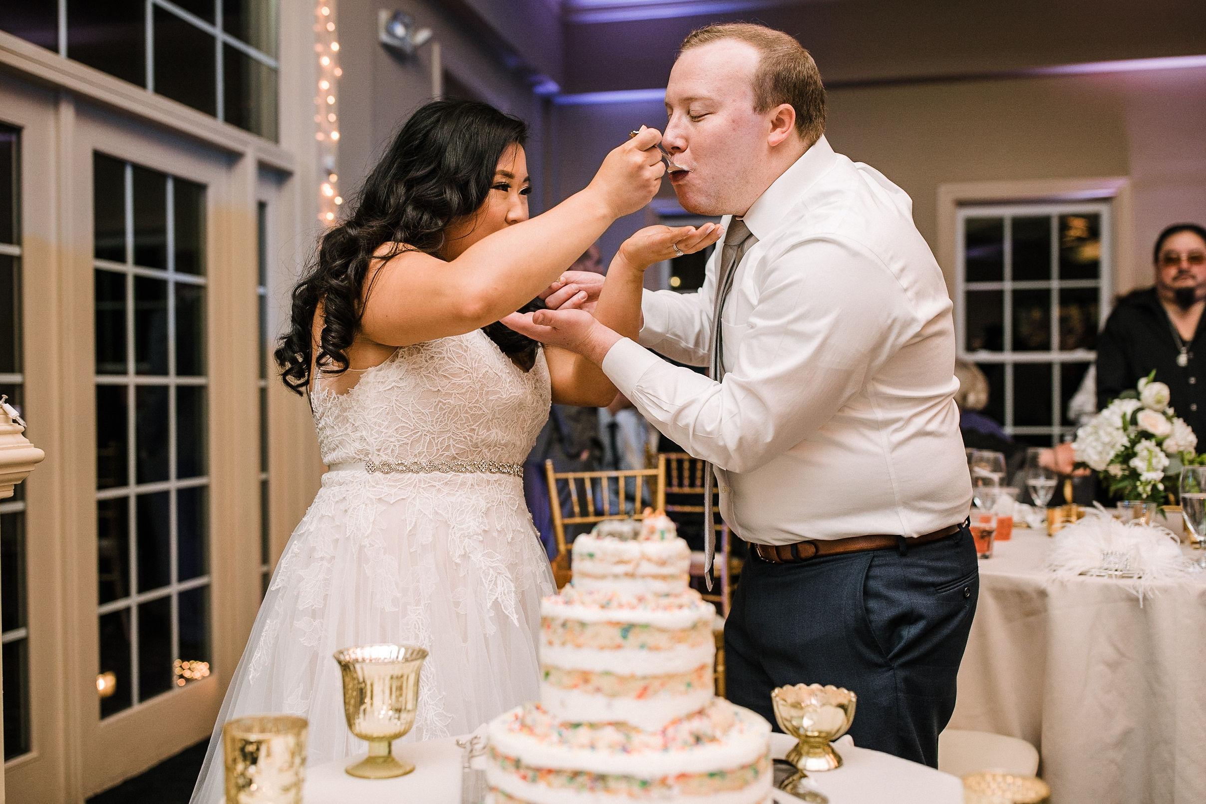 bride and groom cut wedding cake at Westfields Golf Club