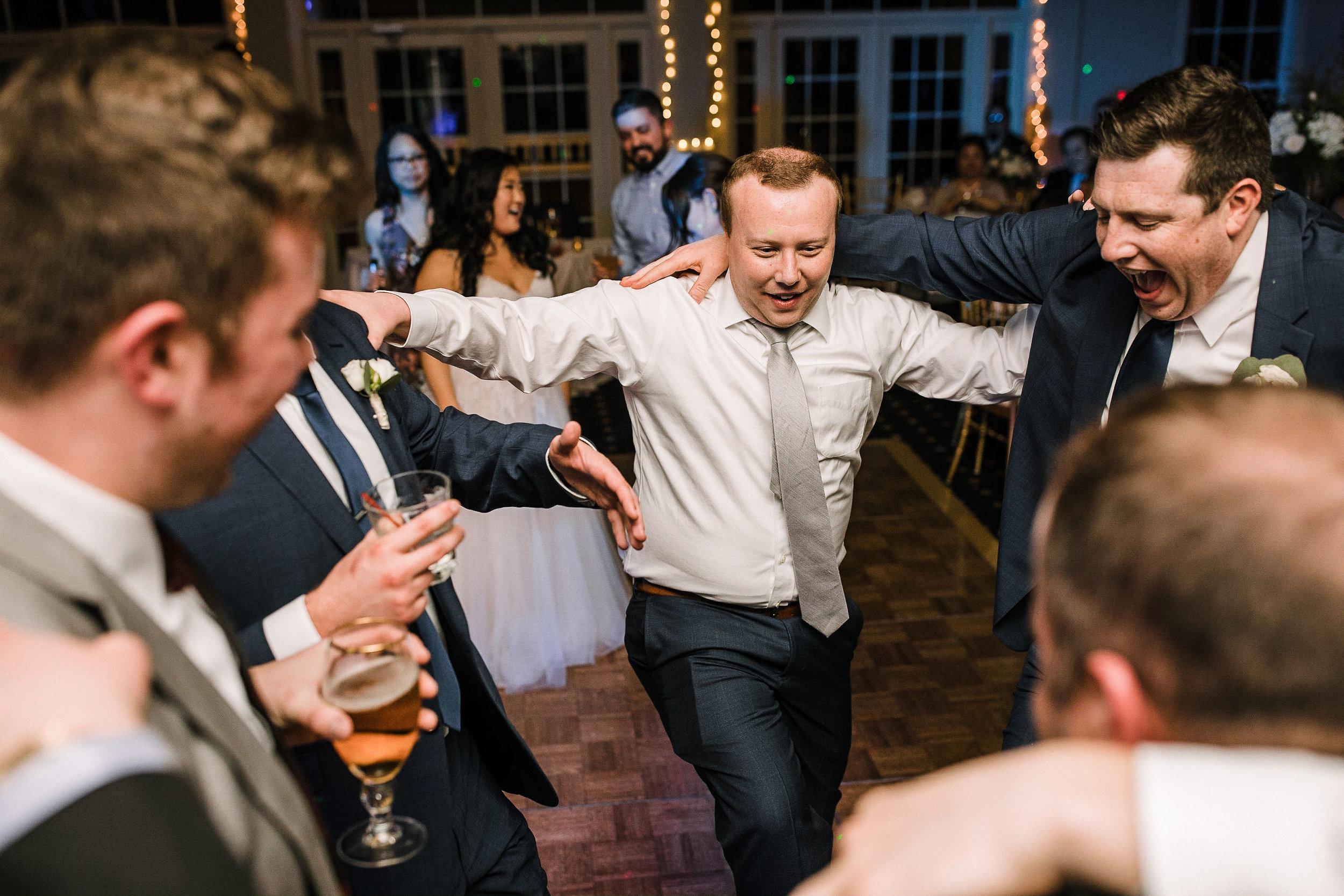 groom and groomsmen dancing at Westfields Golf Club