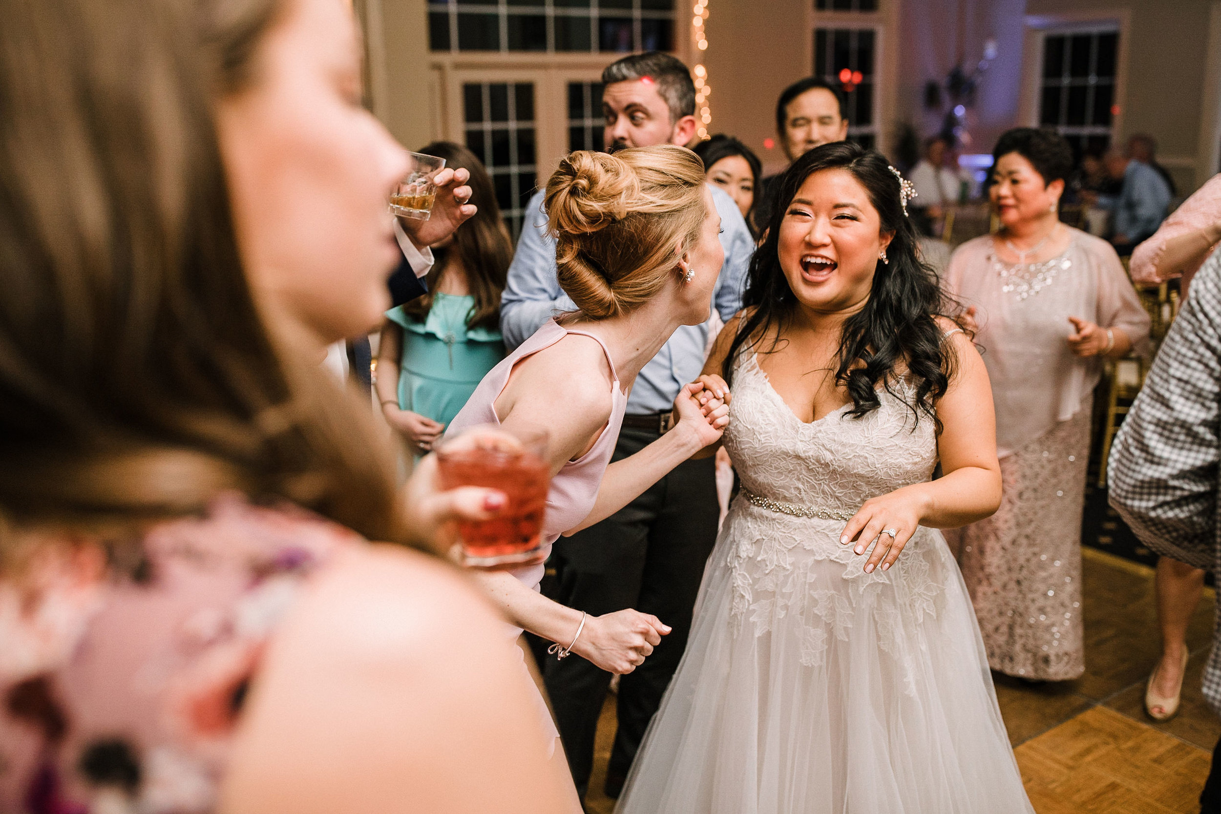 bride and guests dancing at reception at Westfields Golf Club