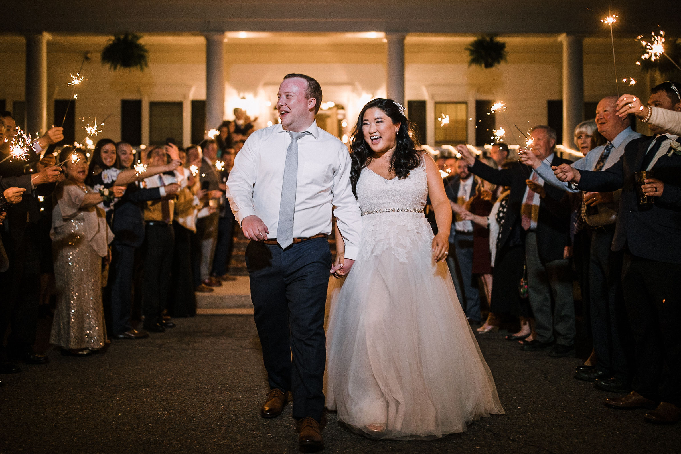 bride and groom leaving reception under sparklers at Westfields Golf Club