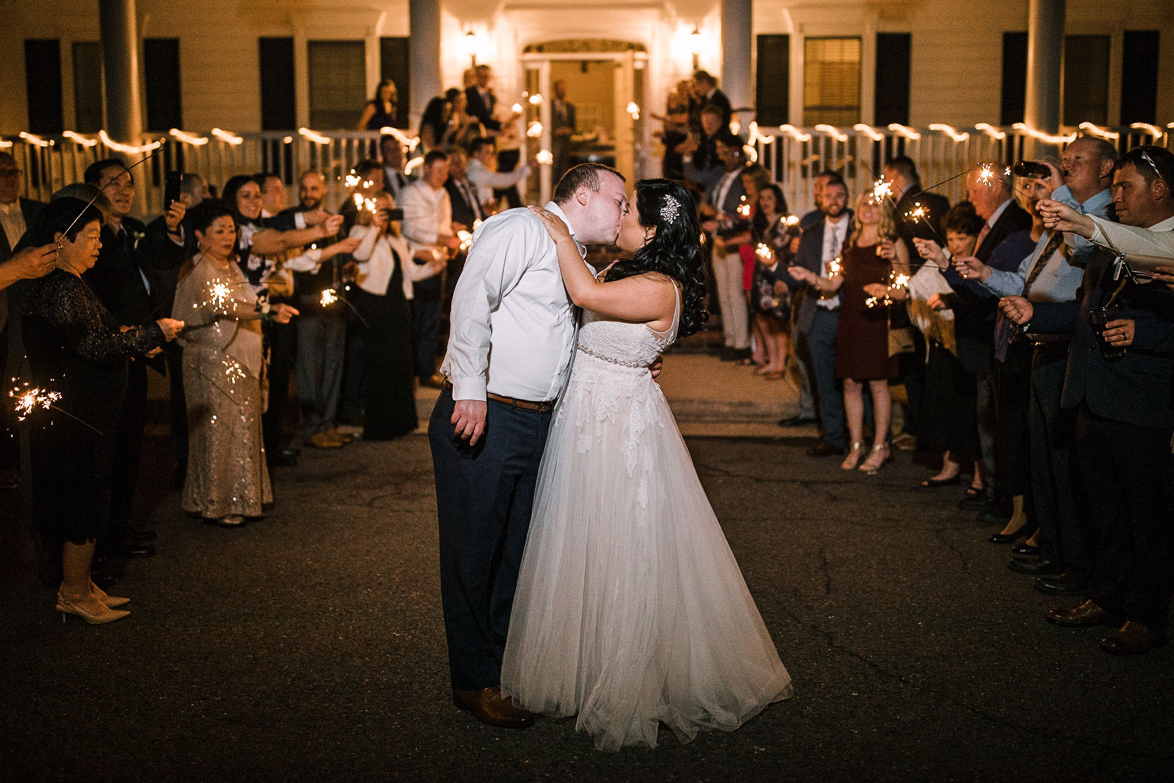 bride and groom kiss under sparklers at Westfields Golf Club